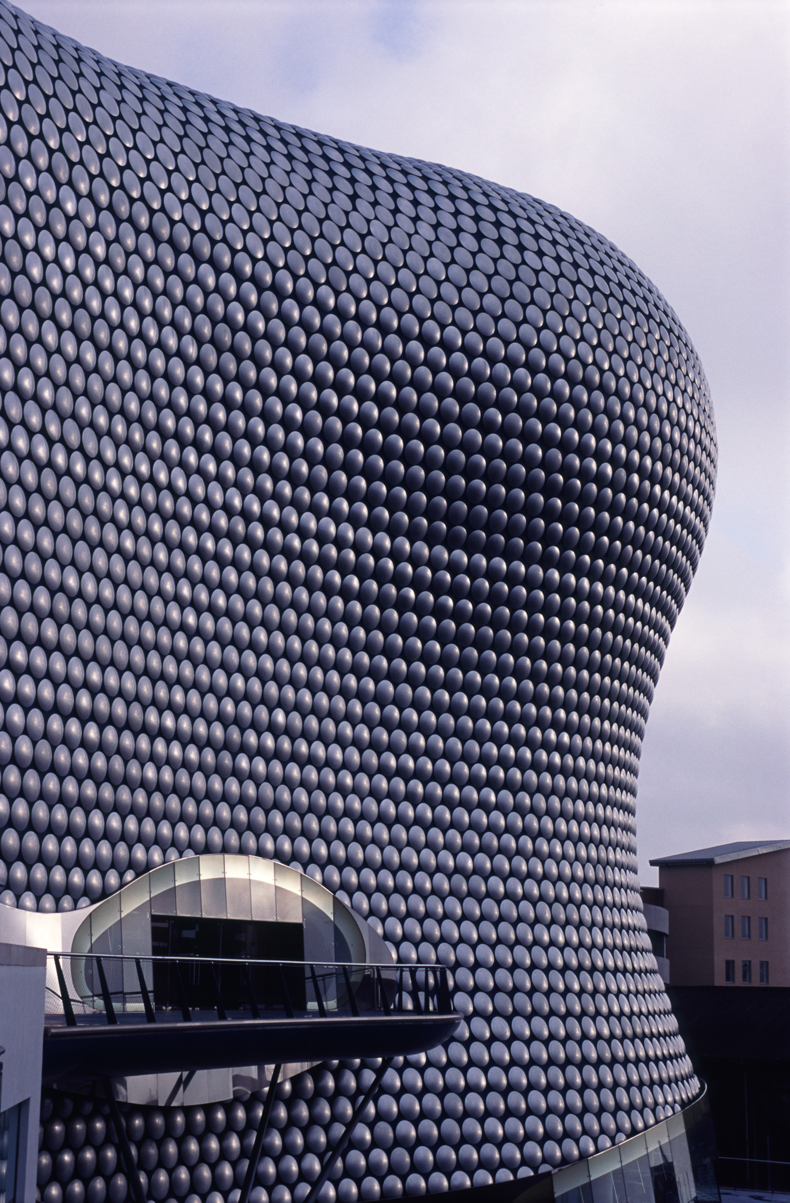 Exterior facade of the Bullring Shopping Centre with its modern curved architectural design and entrance, Birmingham, UK