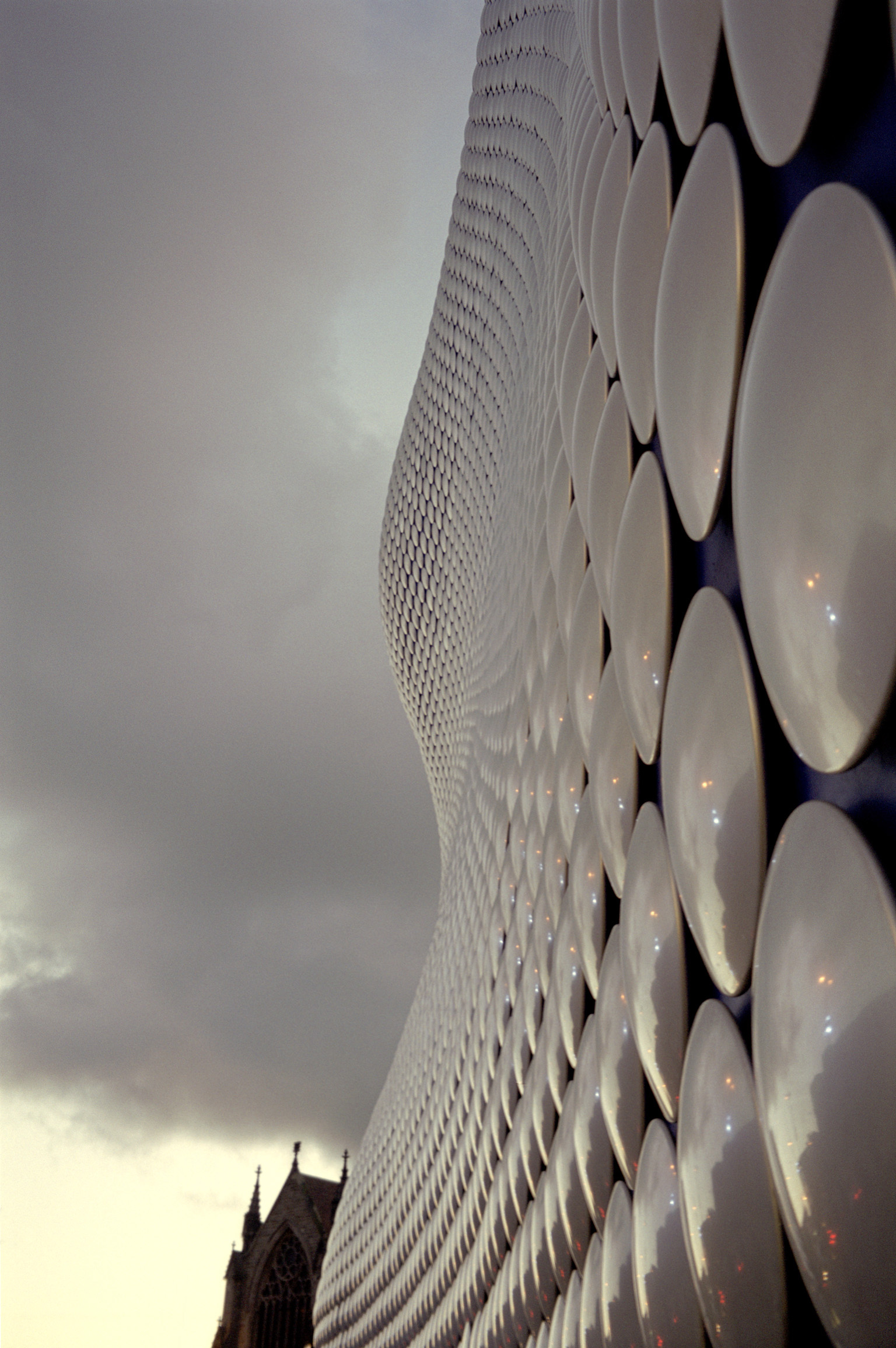Close up Architecture of Famous Selfridges Store at Bullring, Birmingham on Gray Sky Background.