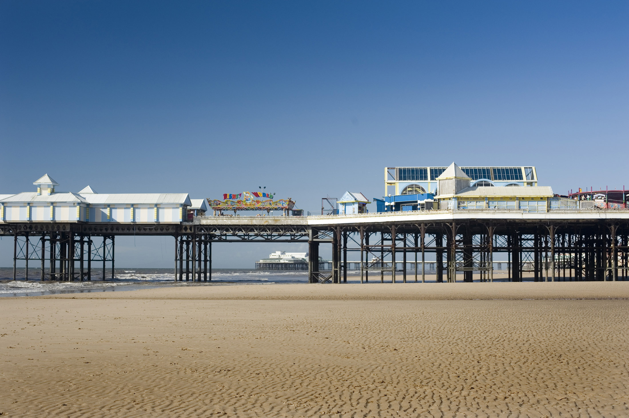 a view of blackpools central pier, the north pier can be seen in the distance