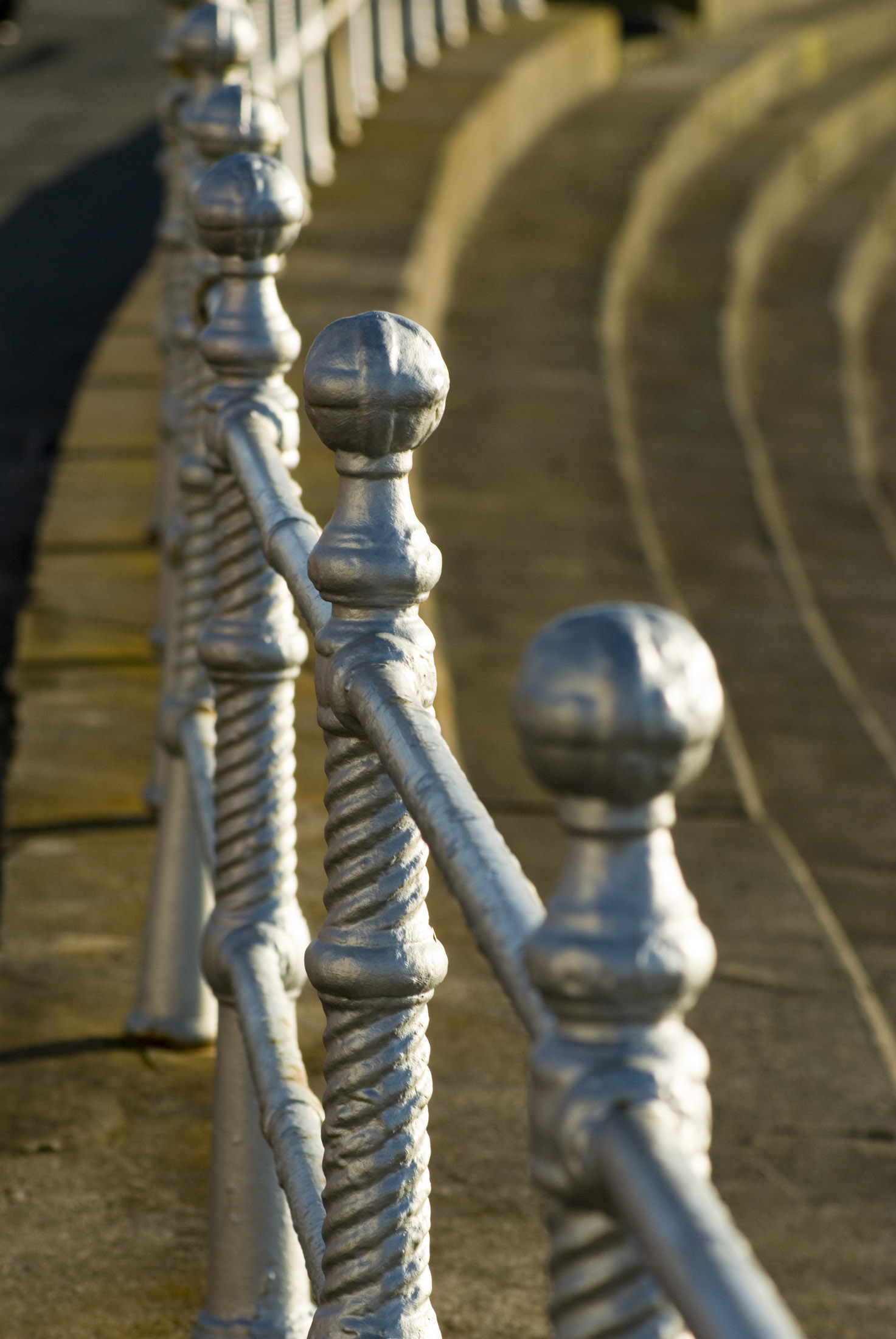 silver painted historic iron railings on the side of blackpool prom