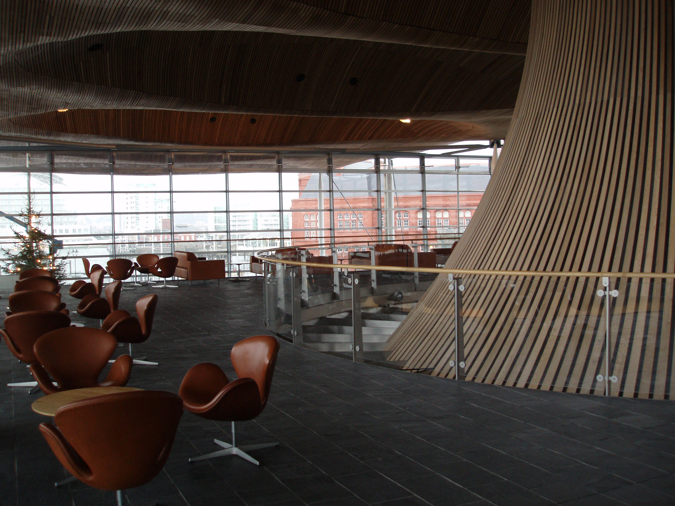Interior view of seating and tables in the Senedd, or national Assembley Building in Cardiff, Wales