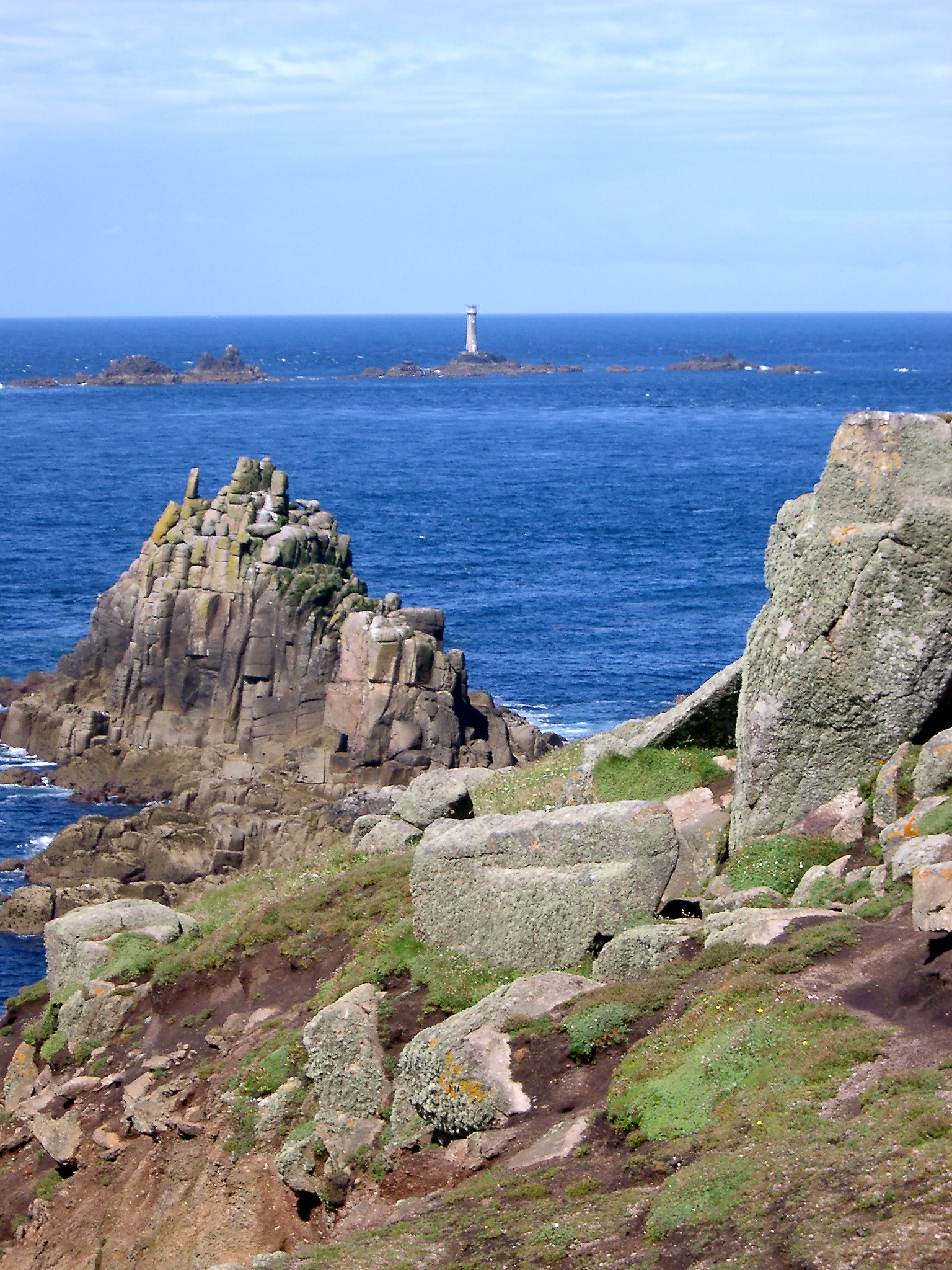 coastal outcrops and the longships lighthouse at lands end cornwall