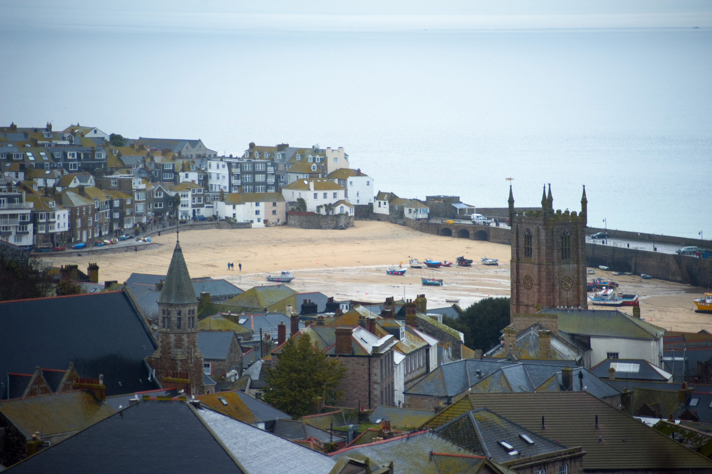 a telephoto view looking down over the rooftops of st ives, cornwall
