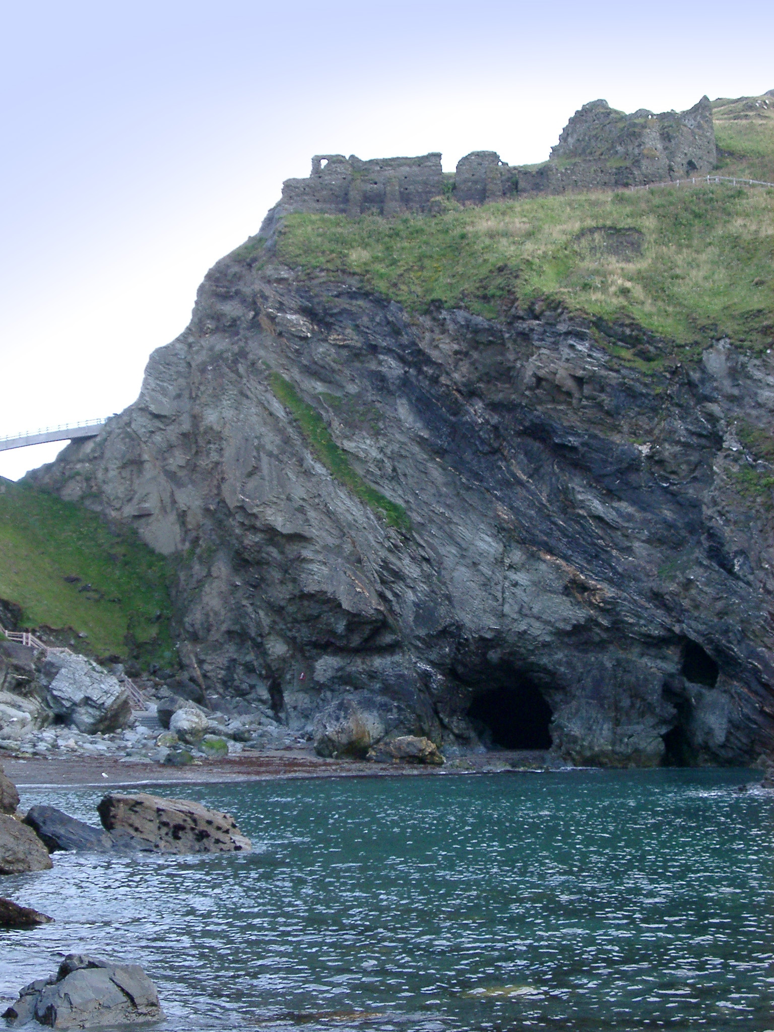 a view across the bay to the castle ruins at tintagel