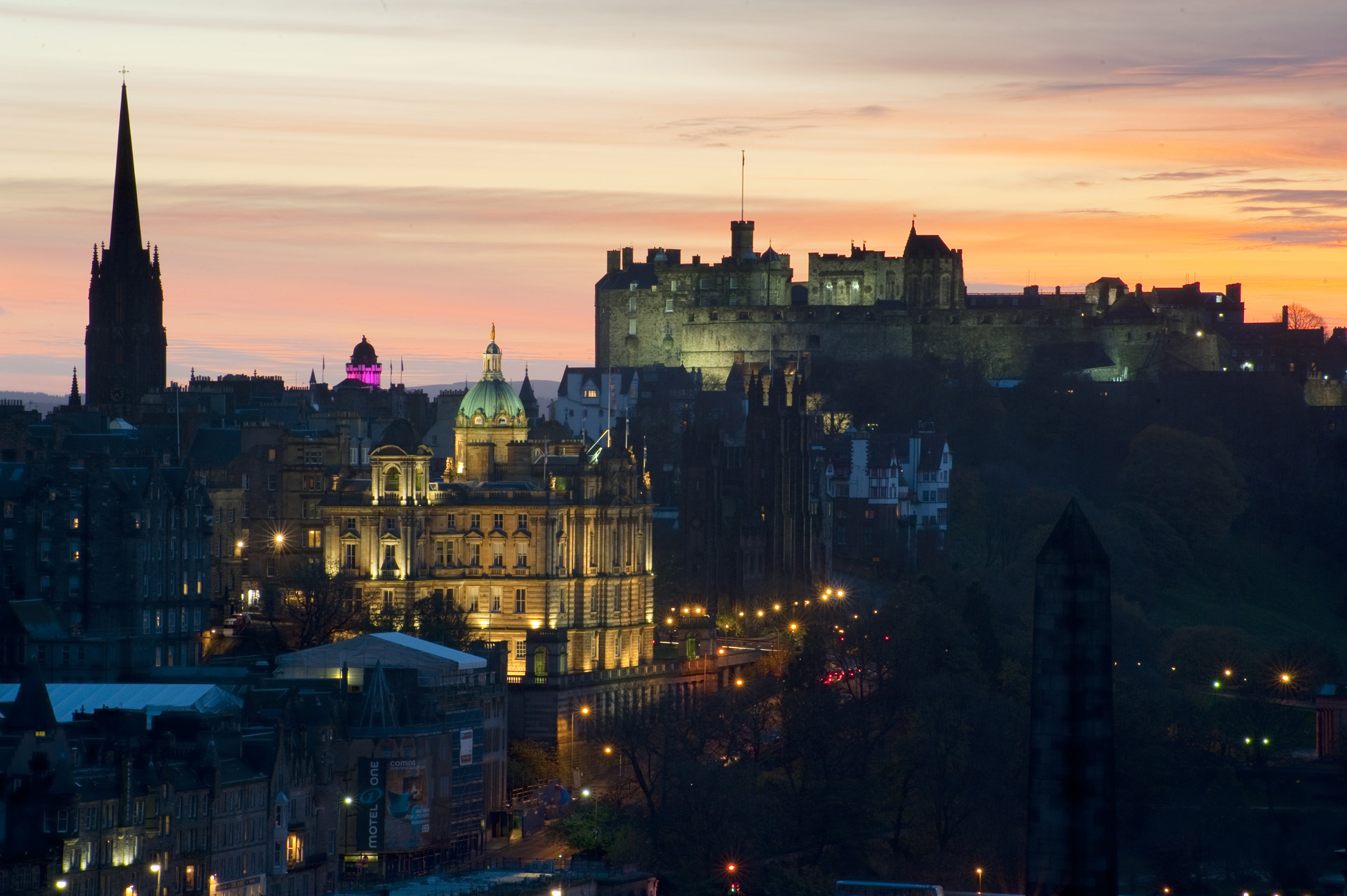 Floodlit at night, edinburgh castle, the camera obscura (pink) and other landmarks in the so called Athens of the north