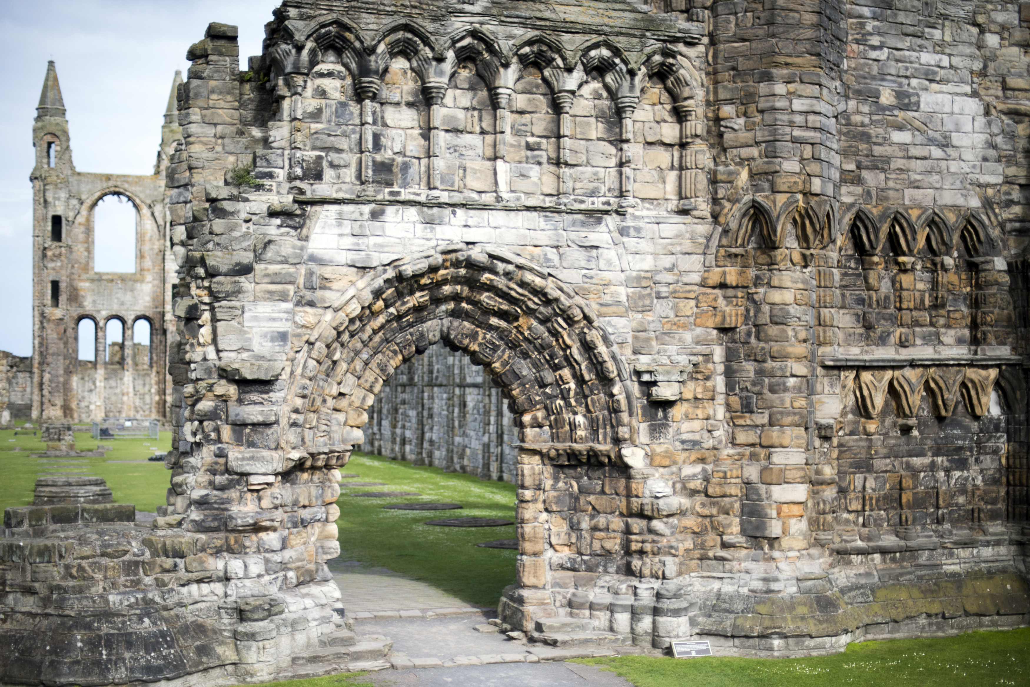 View on front facade of Saint Andrews cathedral with early English type gothic arch and weathered bricks