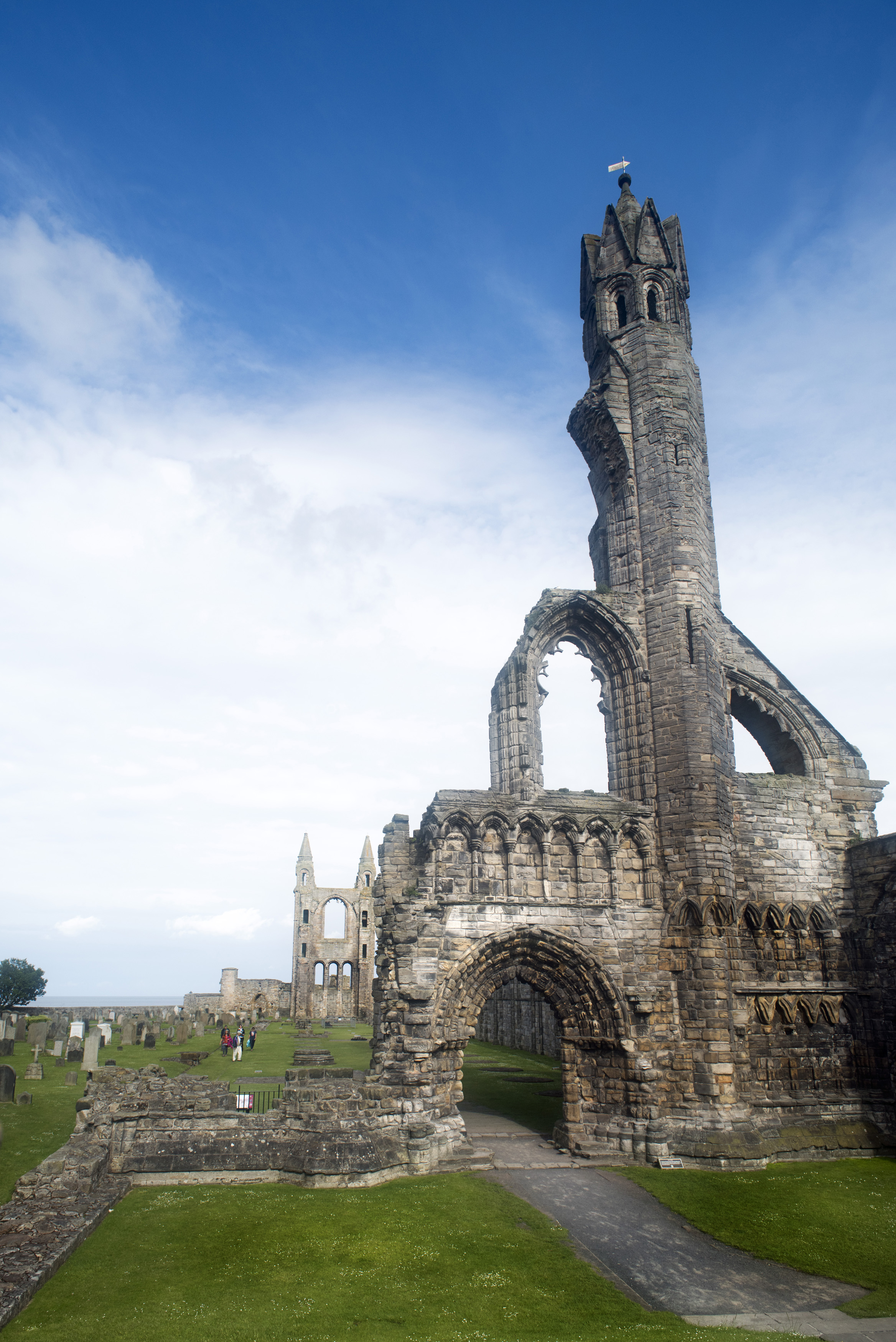 Beautiful Scottish ruins of St. Andrews cathedral as feathery clouds stretch overhead