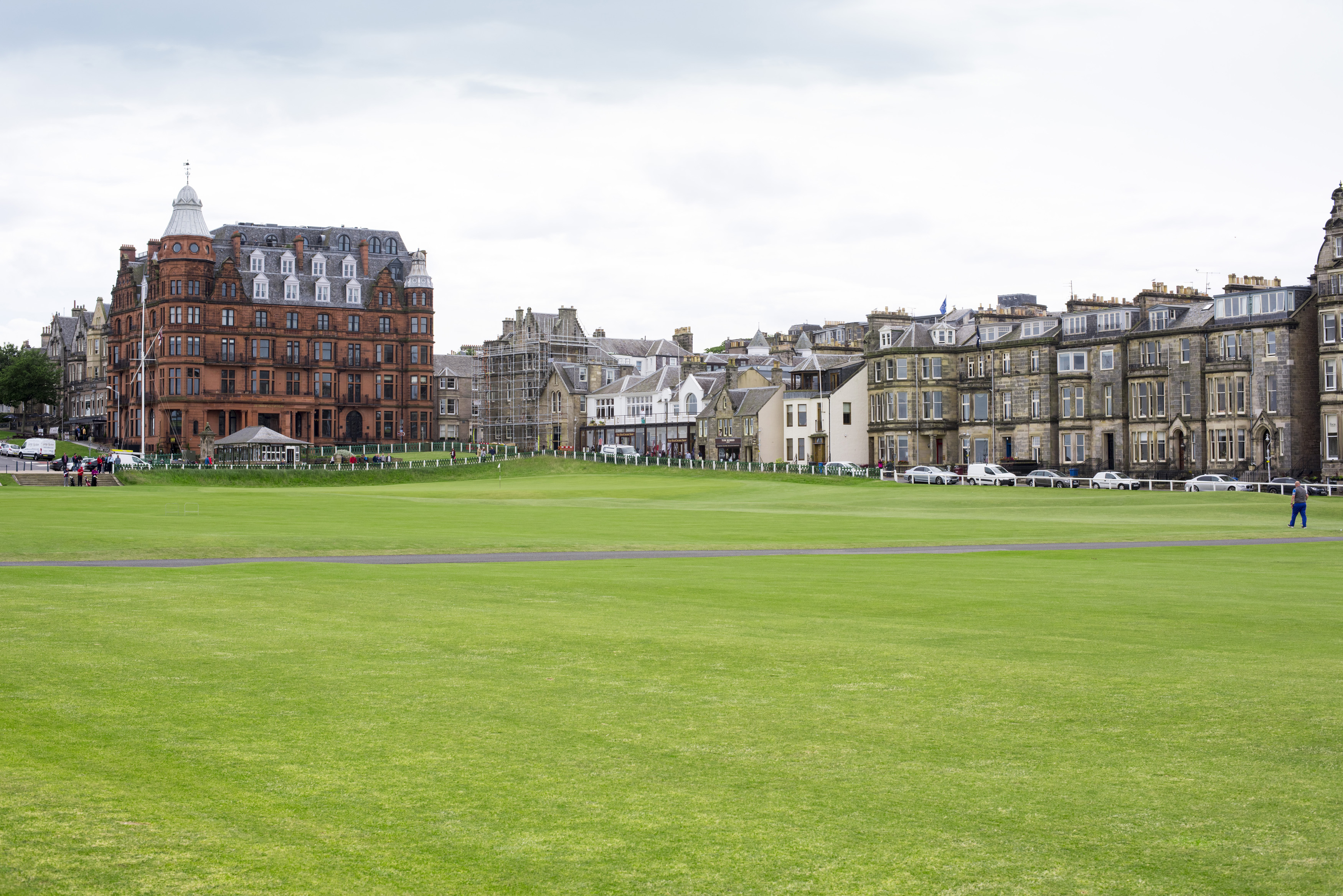 View across the golf course of St Andrews, Scotland with its historic architecture and rows of town houses in a travel and sport concept