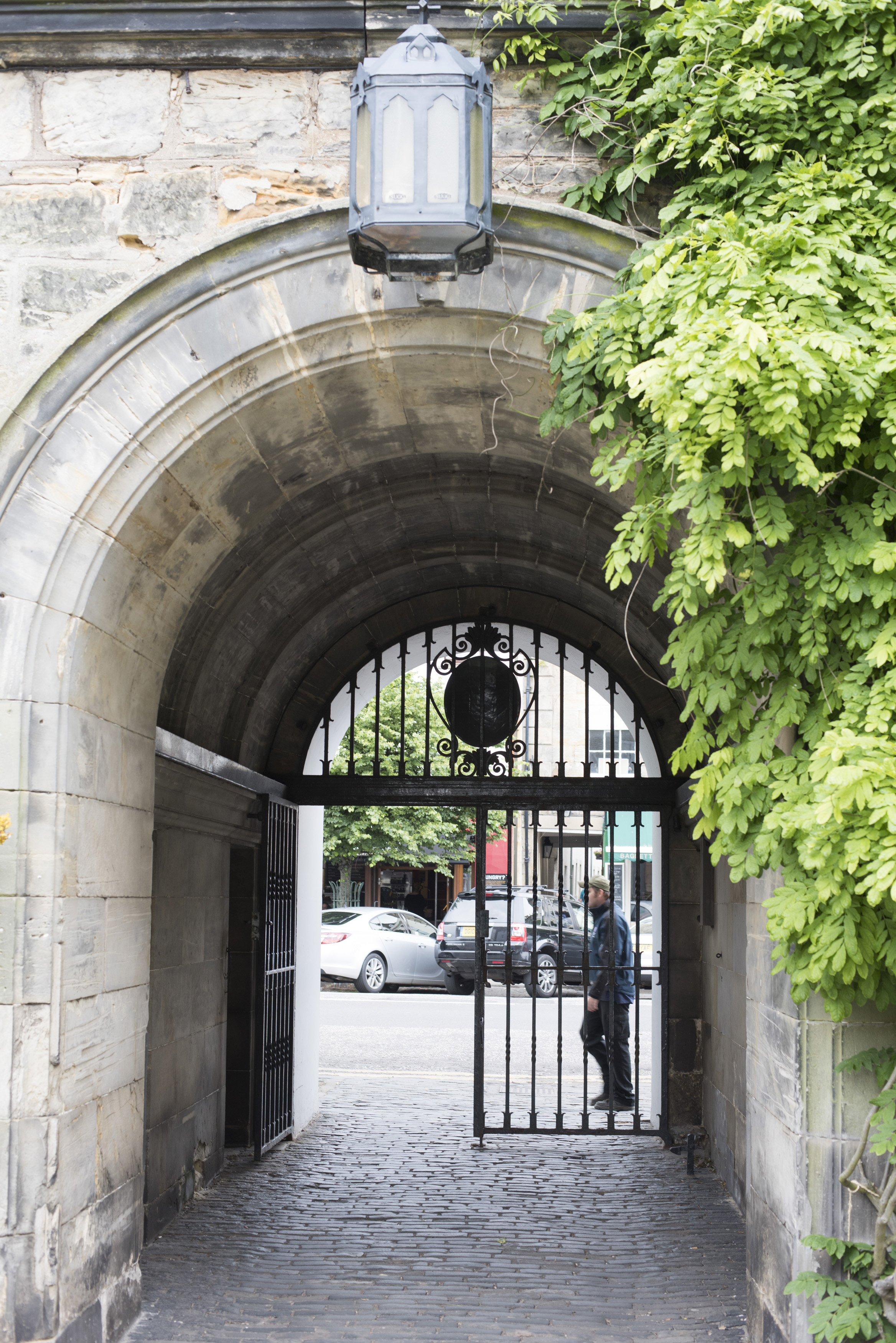 Iron gate and stone archway at the historic European landmark University of Saint Andrews in Scotland