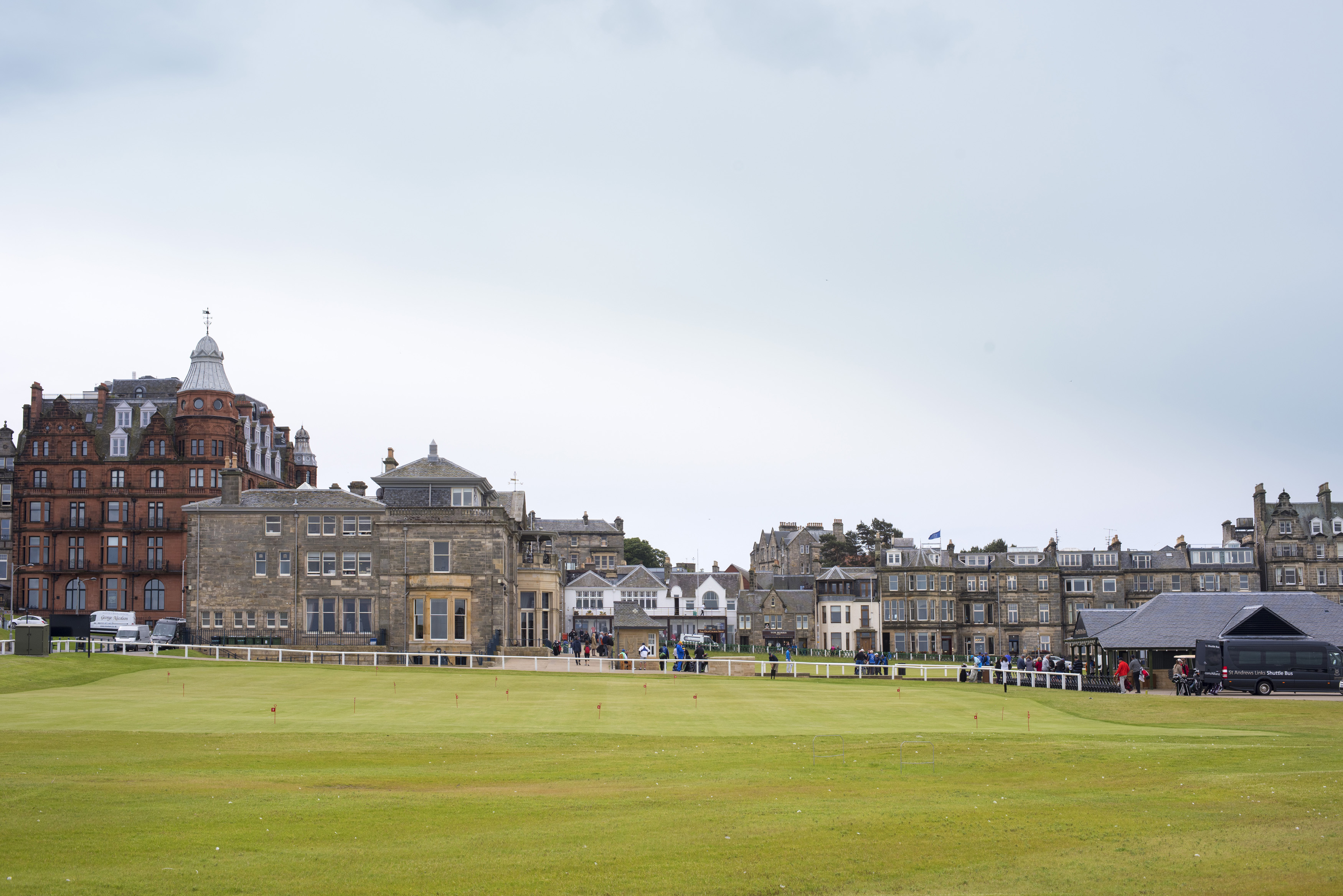 View across an open field of St Andrews, Scotland with its historic architecture in a scenic landscape for a travel and tourism concept