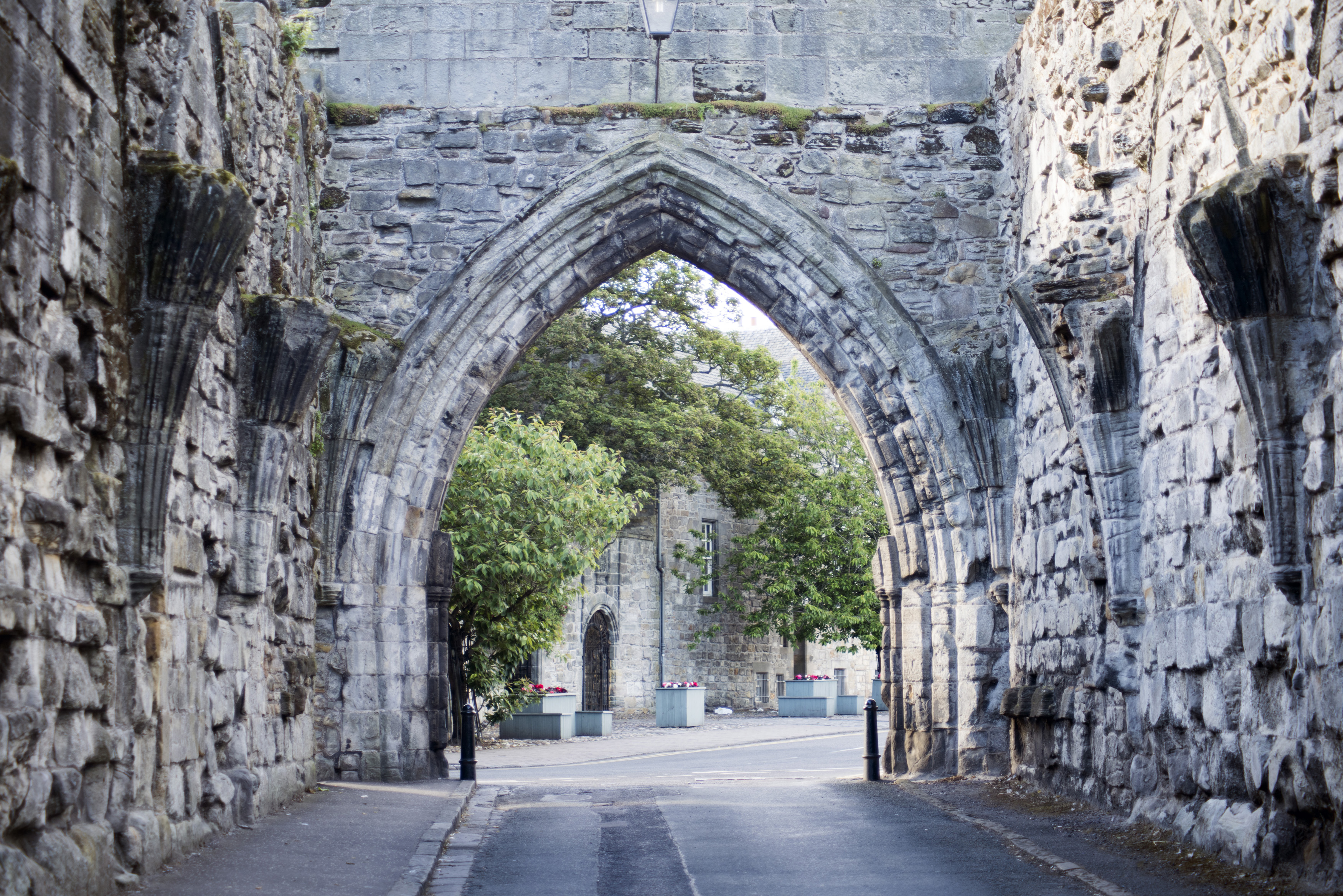 Arched Gothic stone entrance to St Andrews, Fife, Scotland a popular historic tourist attraction