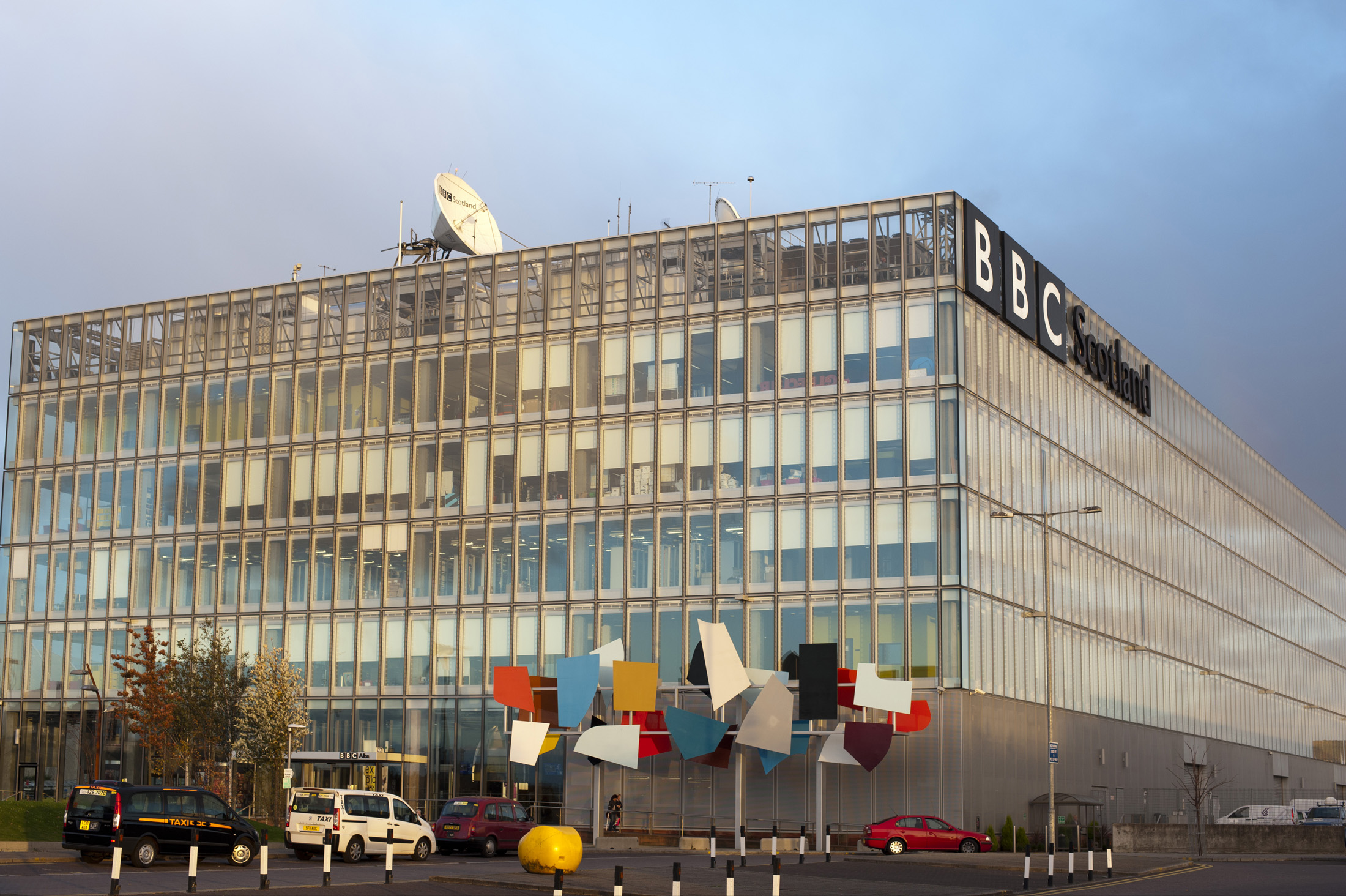 Exterior view of the BBC Scotland building, Pacific Quay, Glasgow with its array of brightly coloured architectural panels in the forecourt