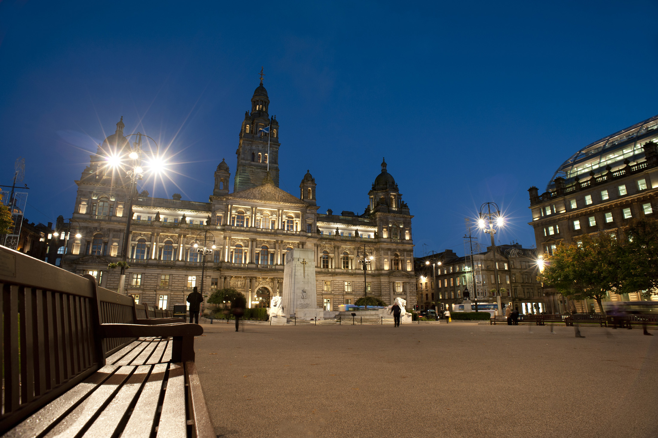a view of george square, glasgow at night