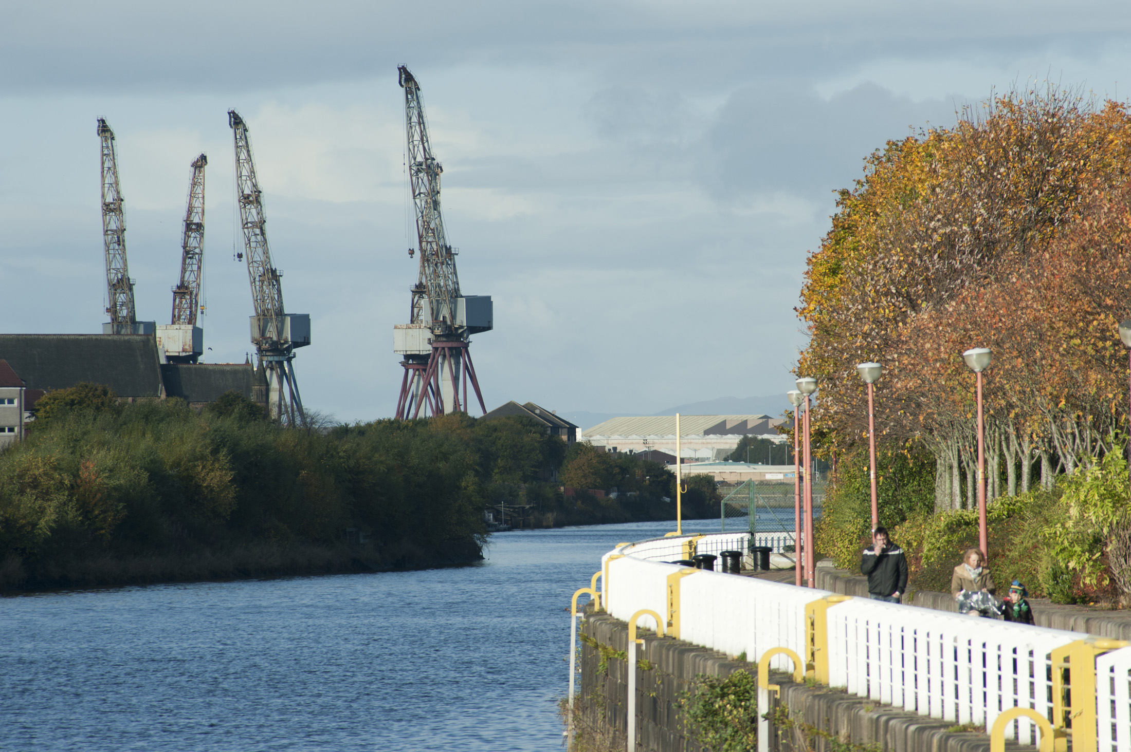 Clyde shipyards in Glasgow Scotland with a view of industrial cranes on the wharf in the shipbuilding terminal