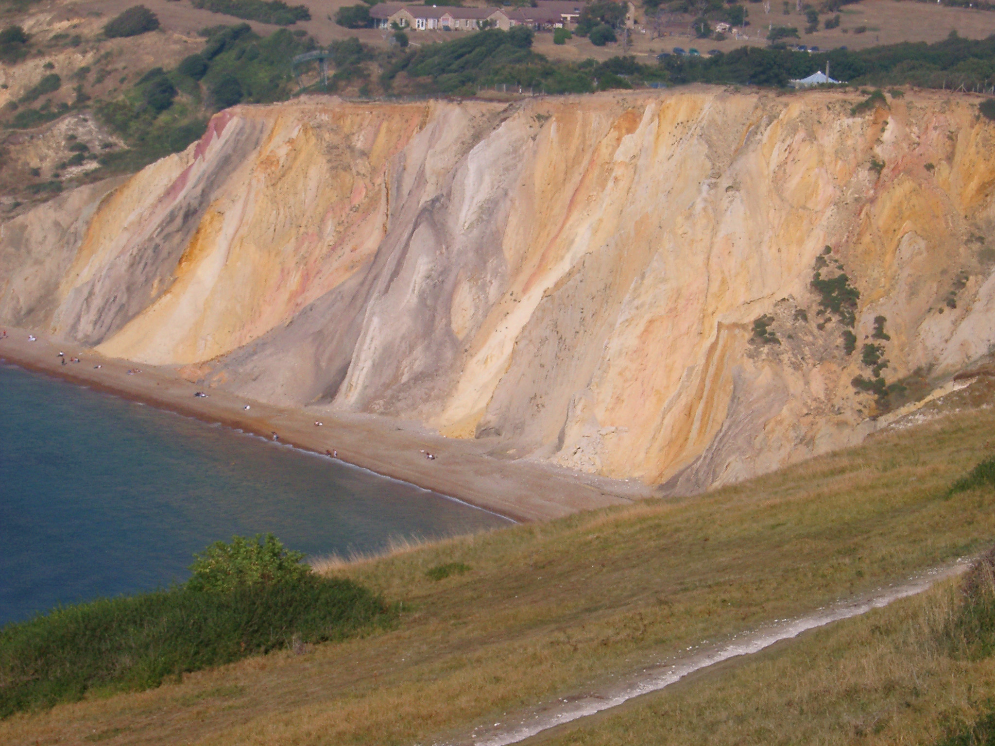 Colorful chalk cliffs eroded by the weather and action of the tides at Alum Bay, Isle of Wight , view from the clifftop