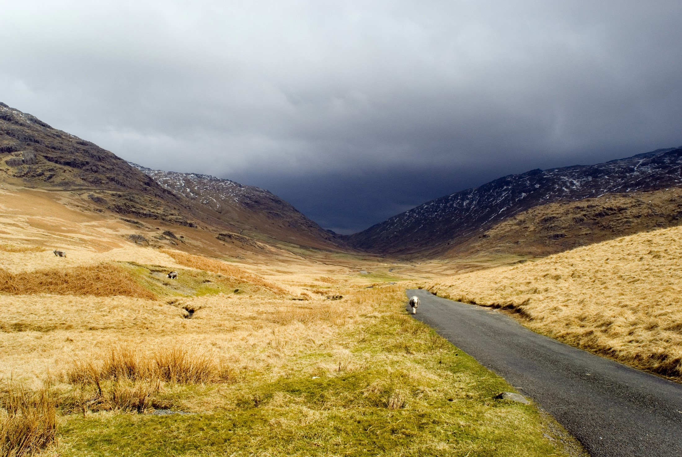 stormy clounds on the road along the hardknott pass driving towards cockley beck and wrynose pass