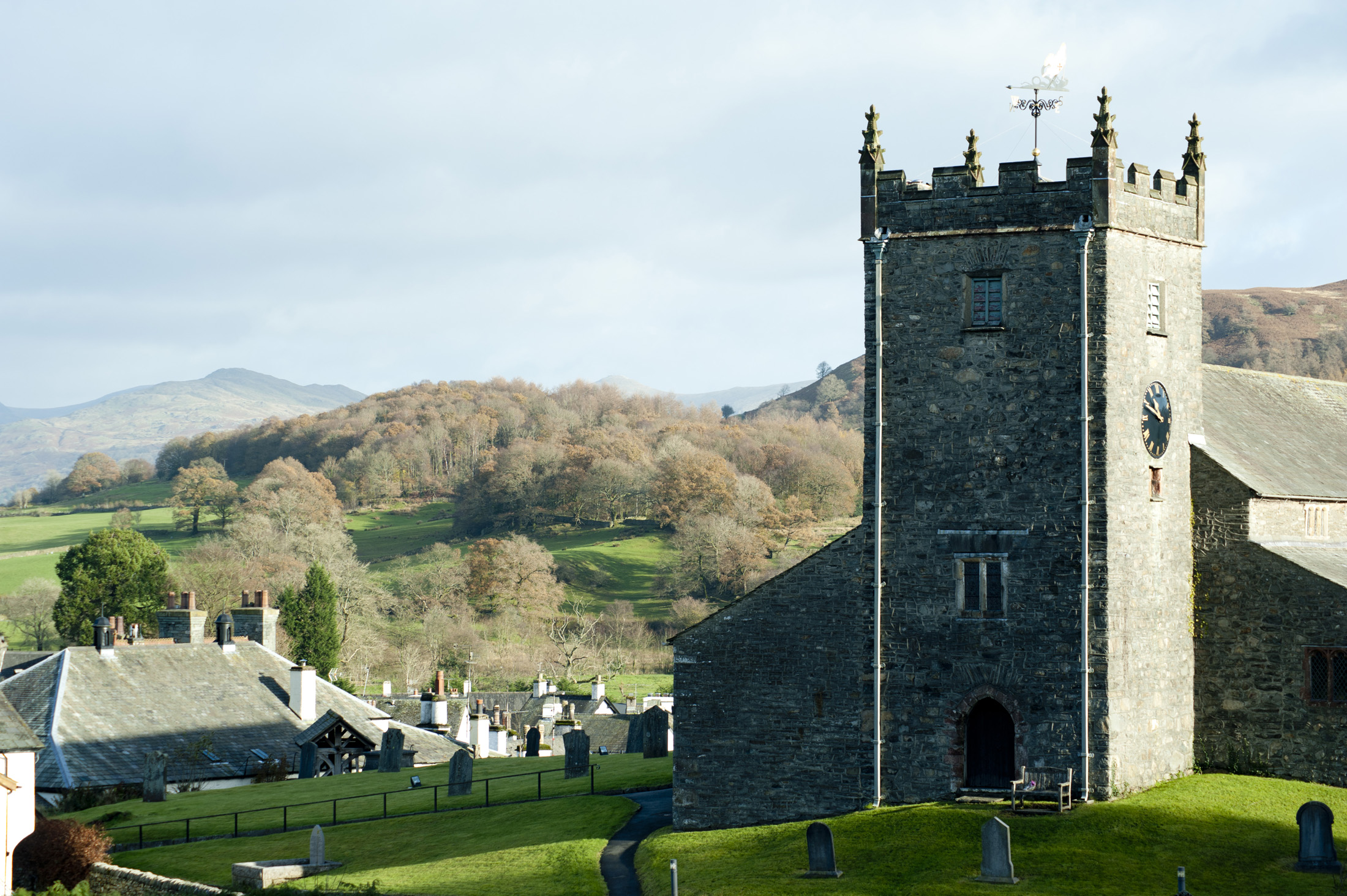 A view of the hawkshead church on a hill overlooking the village and beautiful surrounds