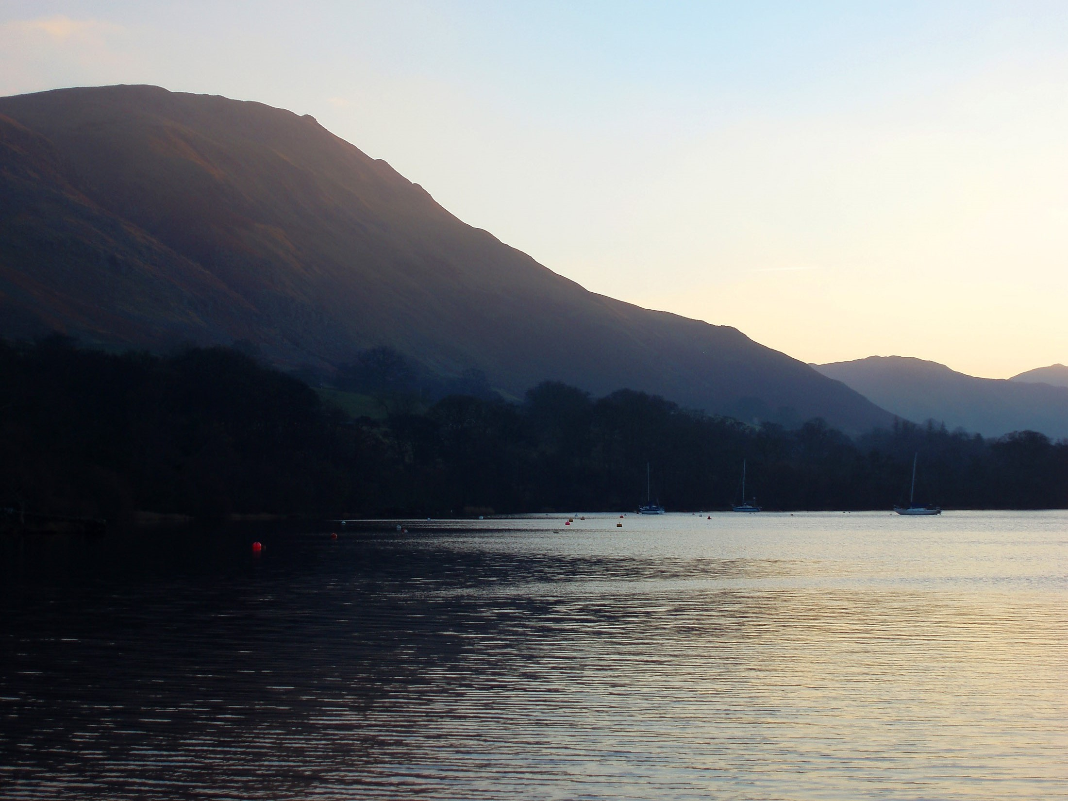 ullswater and surrounding hills at sunset
