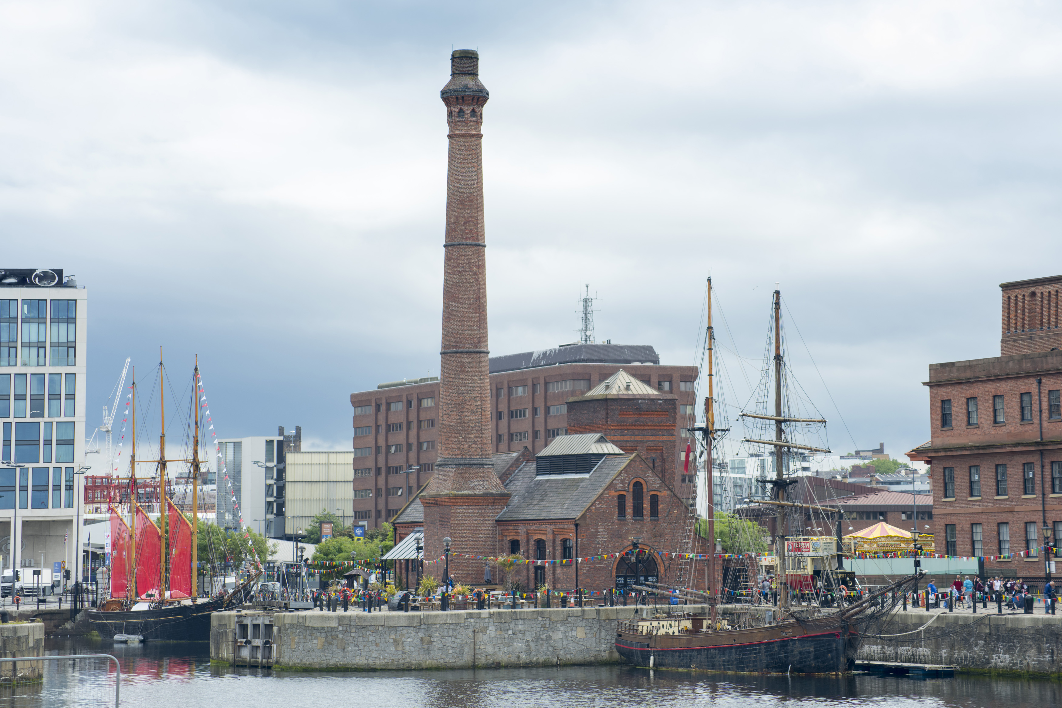 Old power plant with ship at Liverpool Waterfront under overcast sky in the United Kingdom