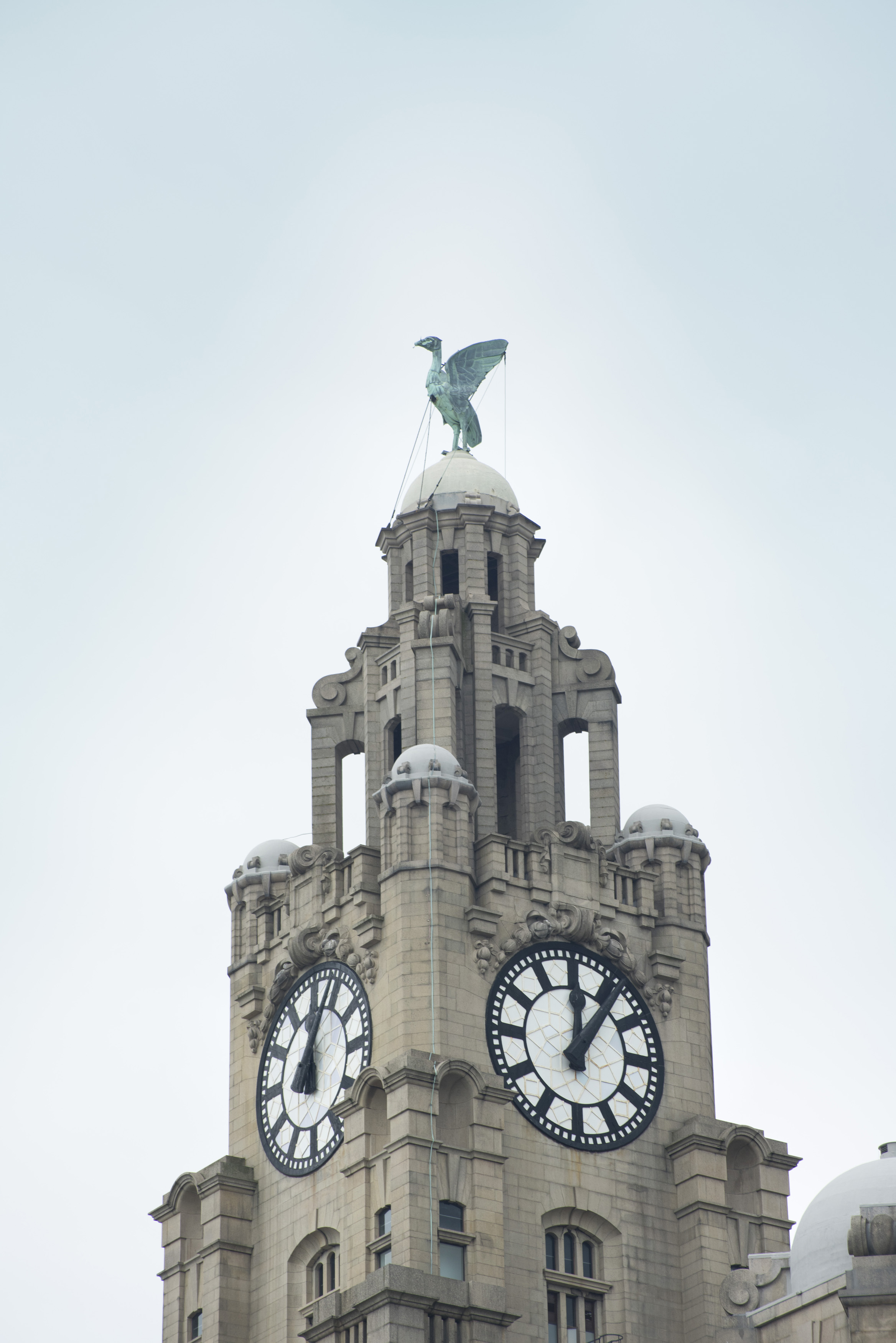 Clock tower on the Liver building, Liverpool, England surmounted by one of the two Liver Birds, a cormorant, wich if it were to fly away would mean the end of the city