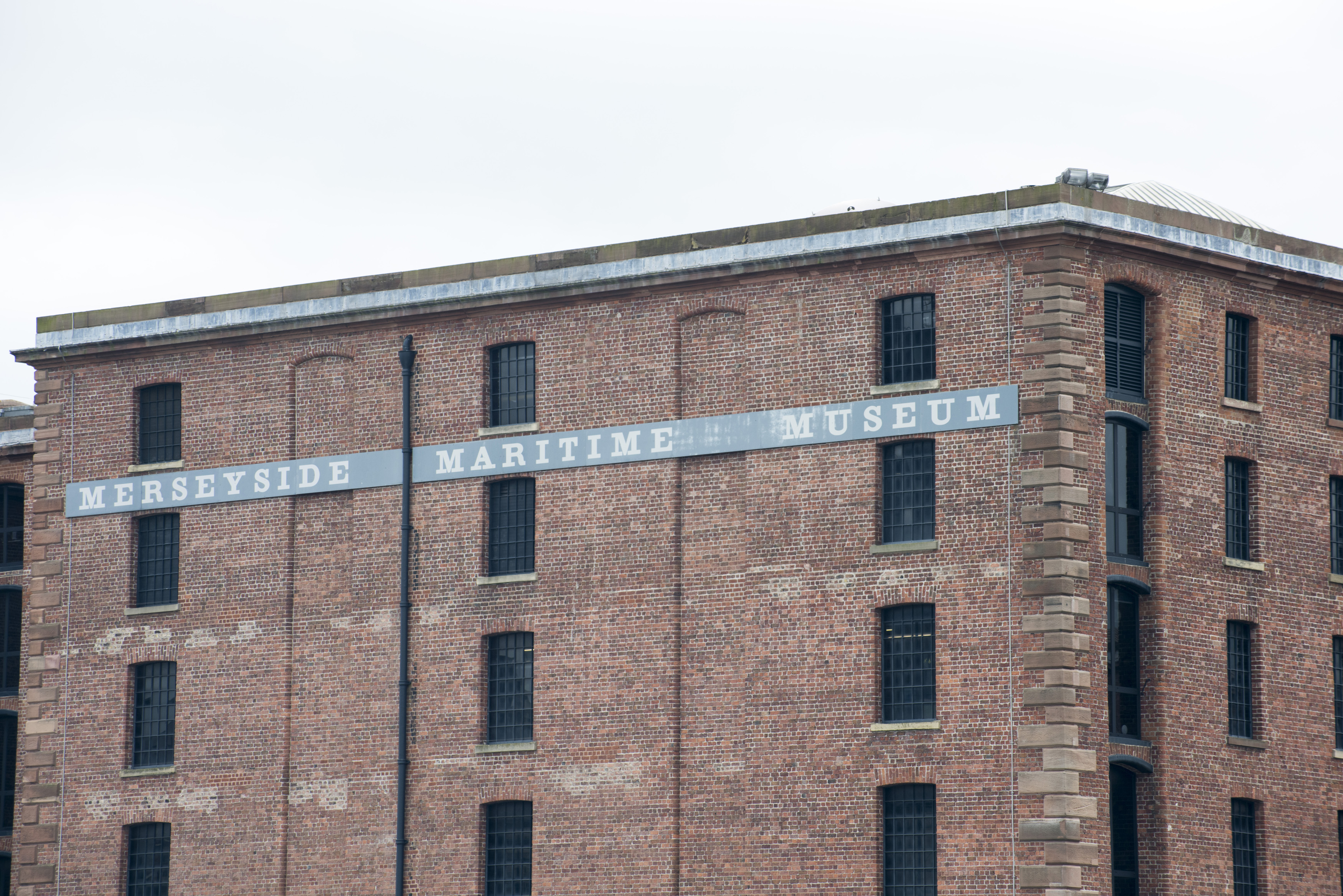 Back wall facing waterfront of Merseyside Maritime Museum building in Liverpool, United Kingdom