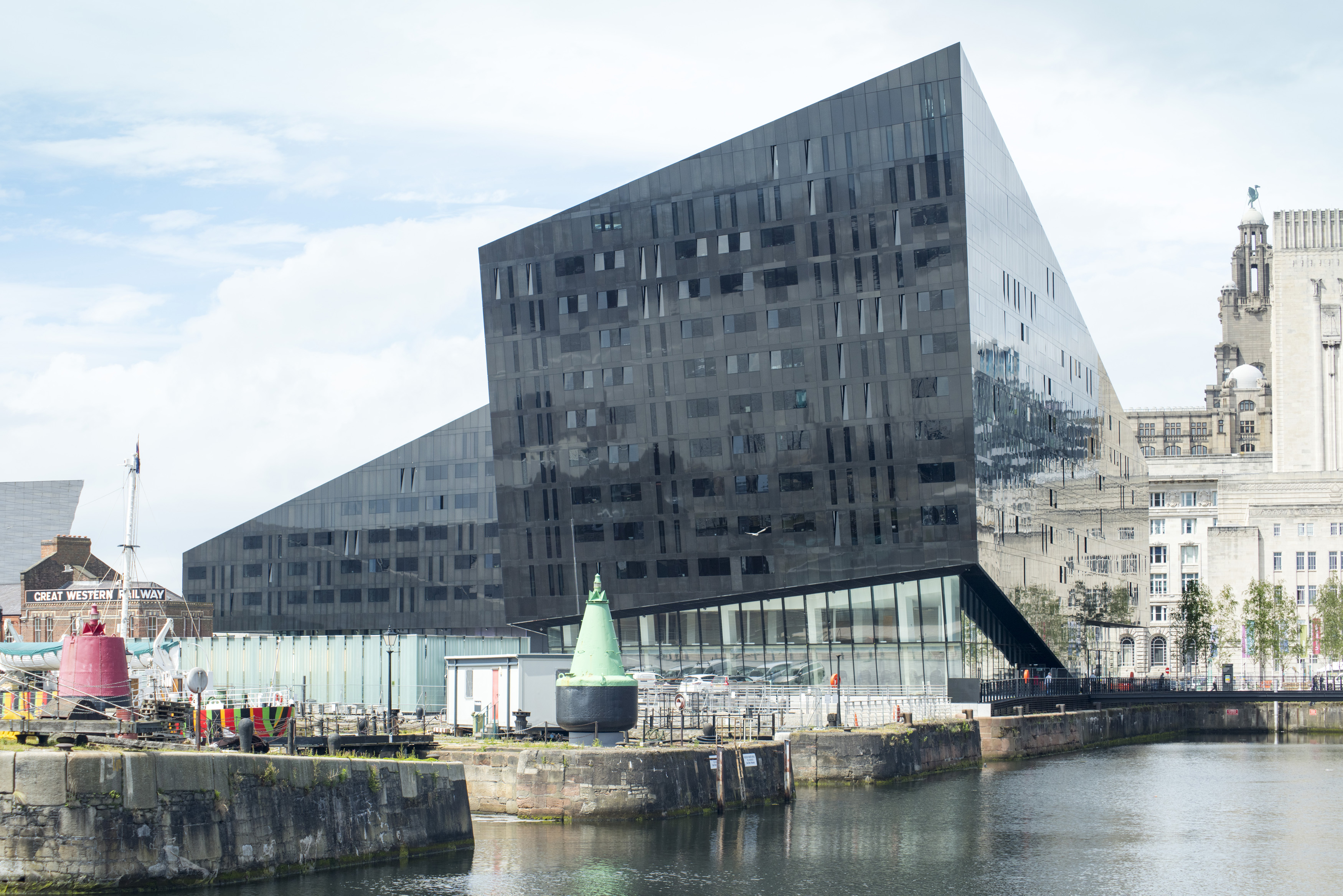 Rhombus shaped black steel and glass building on Mann Island in Liverpool, United Kingdom