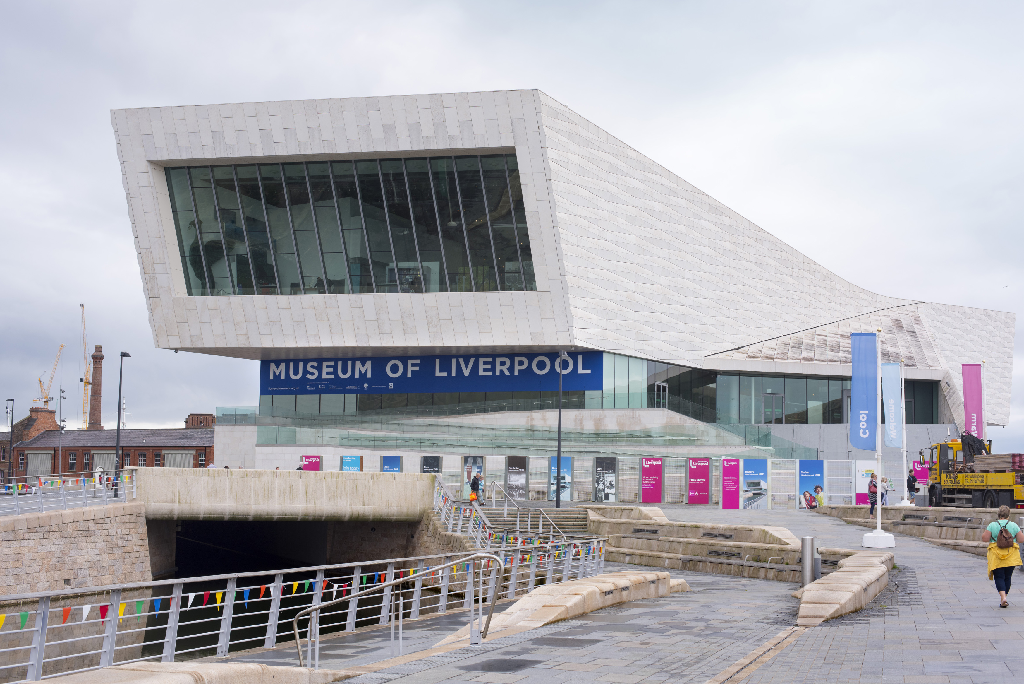 Person walking up road near front section of the Museum of Liverpool in the United Kingdom