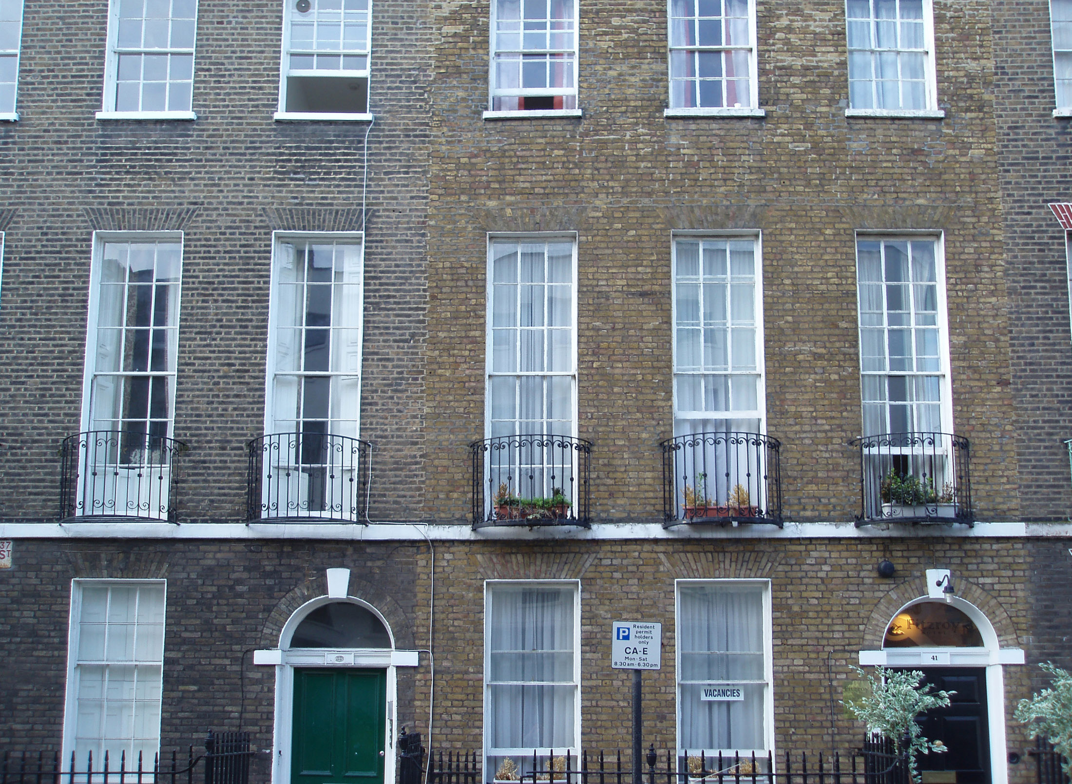 Georgian terraced houses with their tall elegant sash windows and arched entrances in London, UK