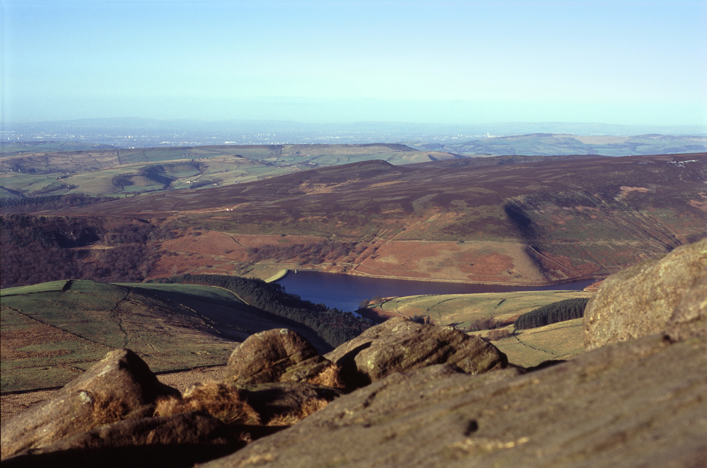View from Kinder Scout of a water resevoir in the hills of the Derbyshire Peak District, UK