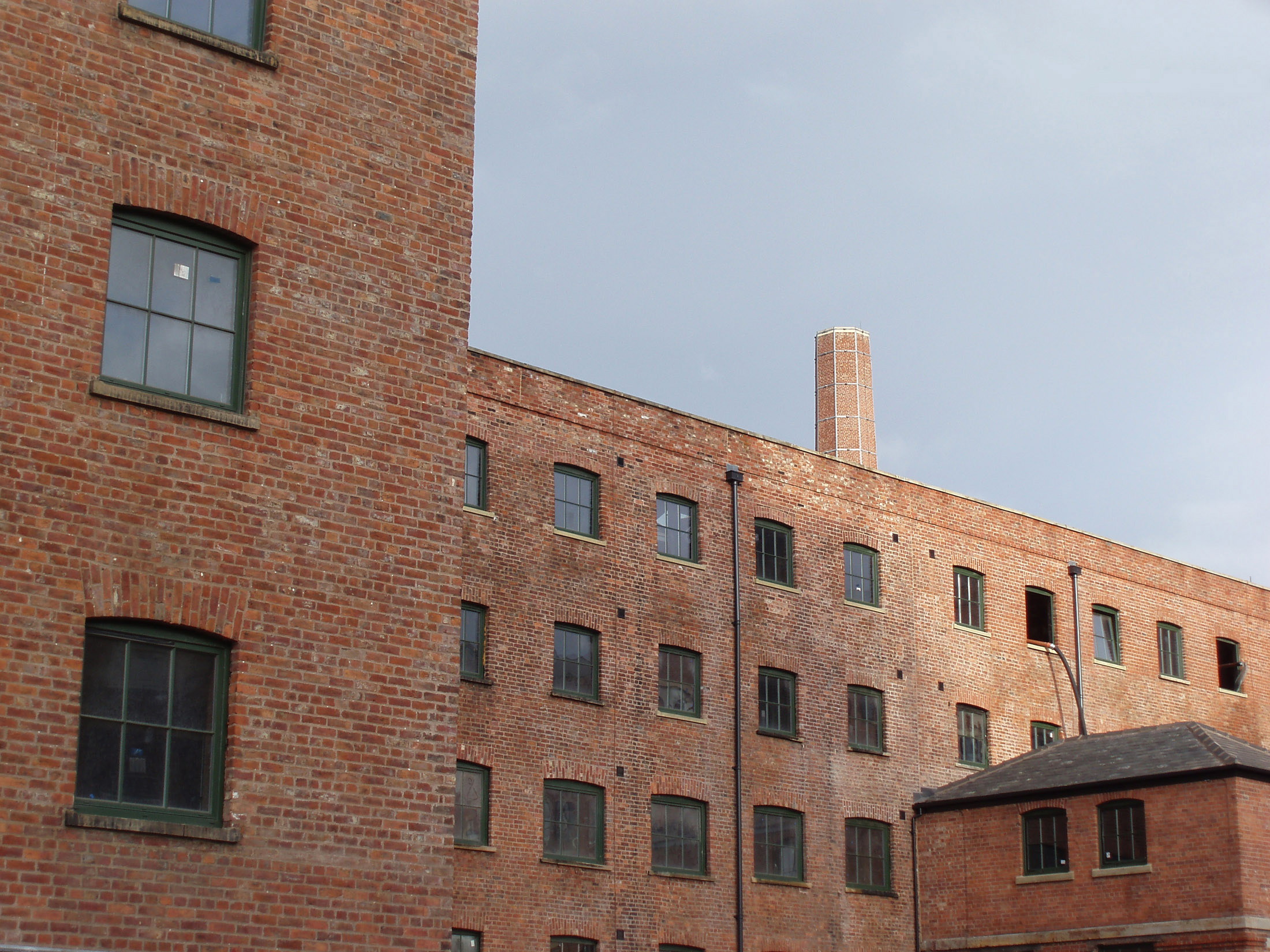industrial eara in central manchester brick frontage of warehouse buildings