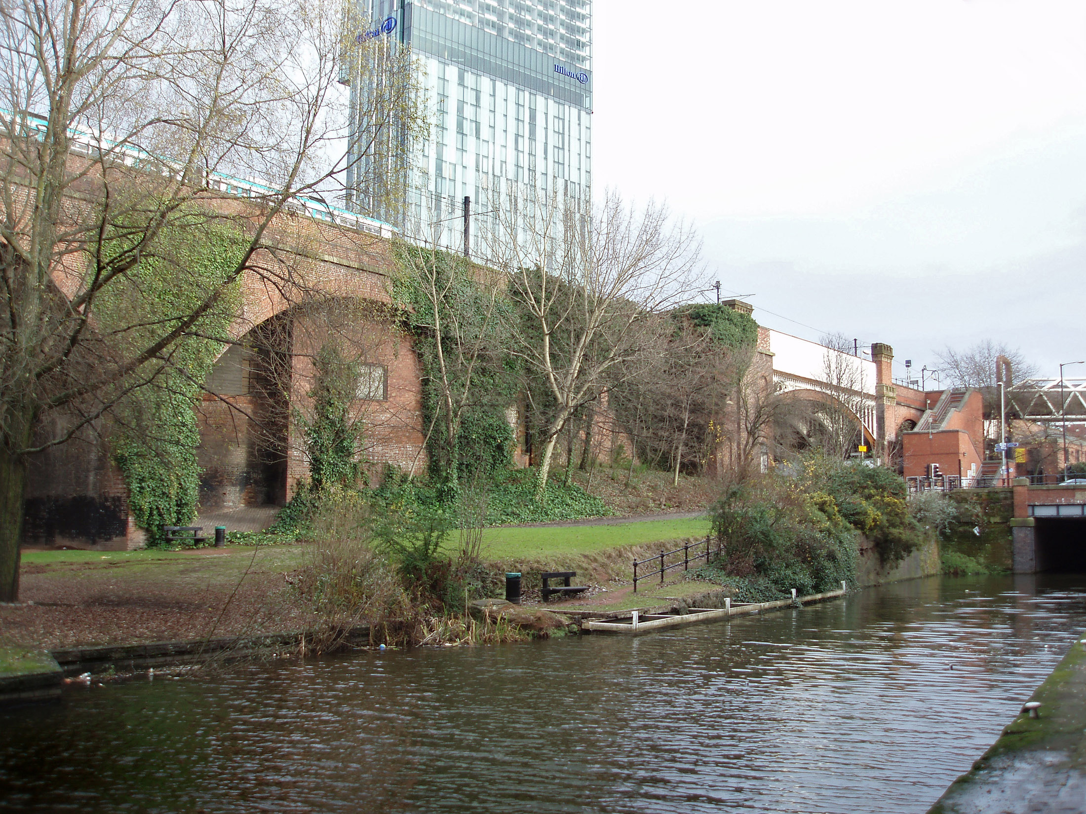 Manchester canal towpath in the Castlefield conservation area in innercity Manchester preserving the first industrial canal and warehouses