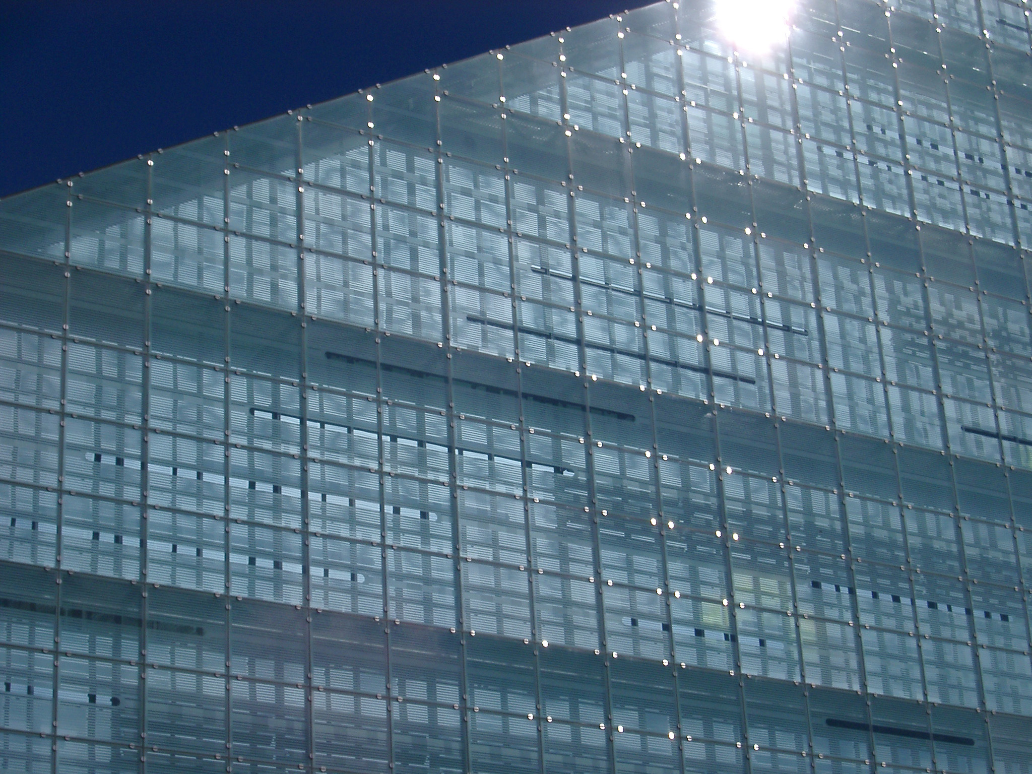 sun glinting off the side of the urbis building in central manchester