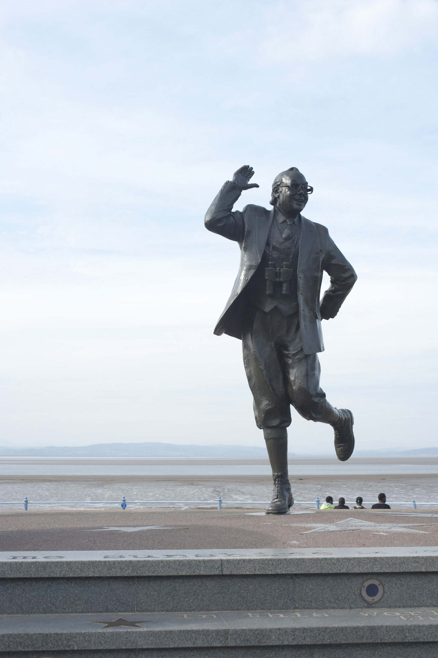 a statue of eric morecambe on morecambe promenade