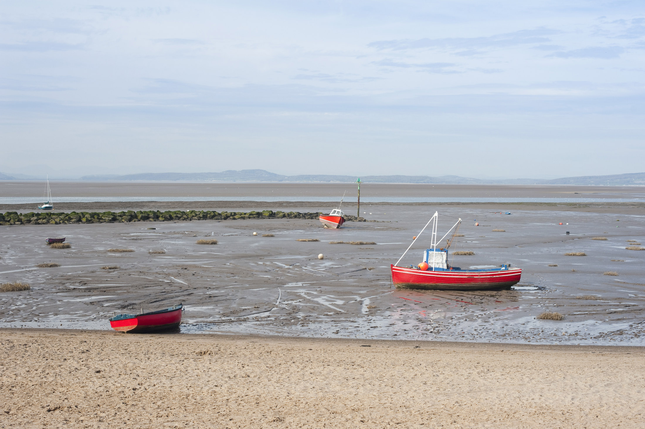 fishing boats on morecambe sands at low tide