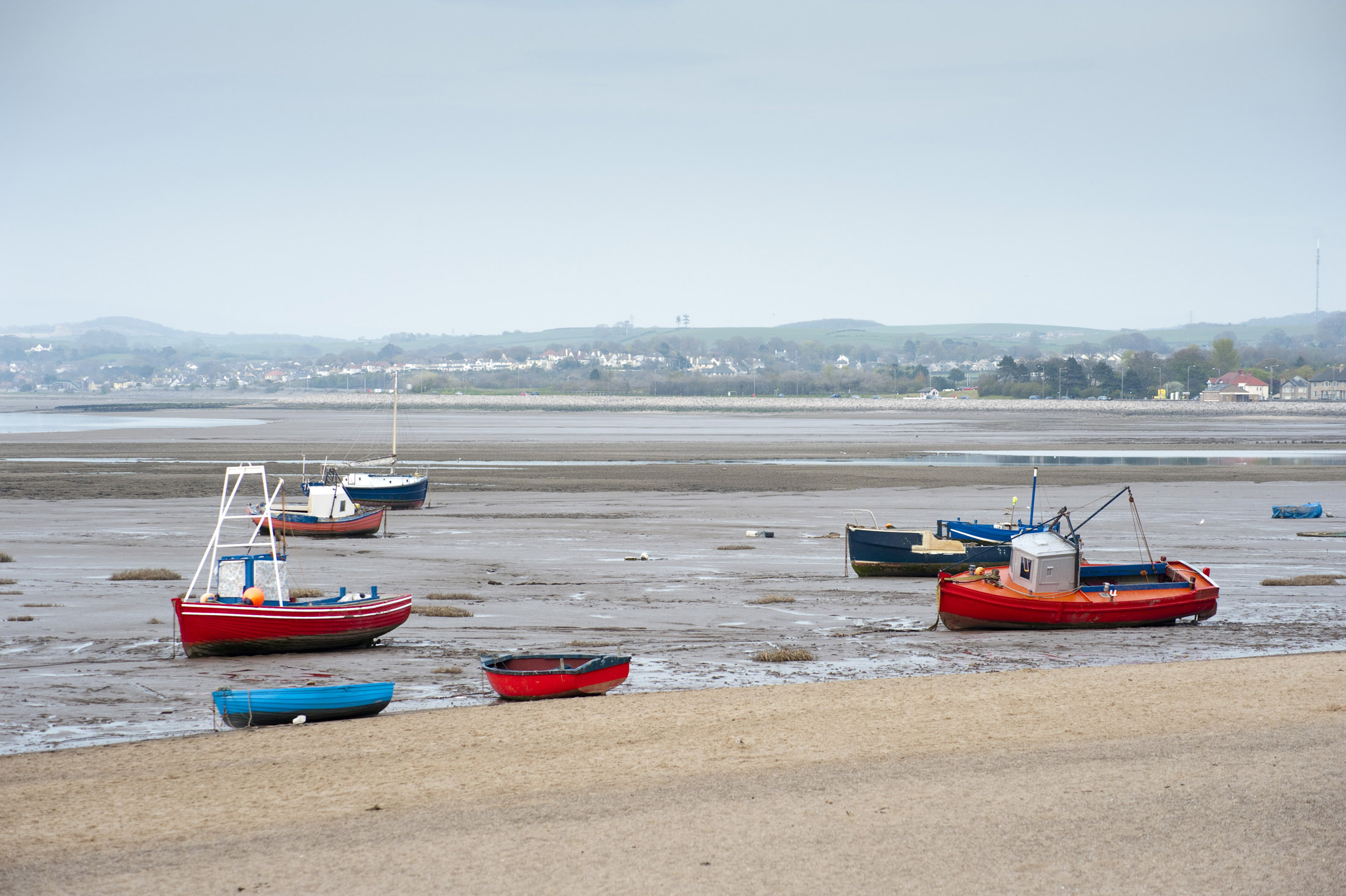 fishing boats at low tide, when the tide goes out in morecambe it goes out a long way, infact the tide has been out since the resorts heyday over 60 years ago