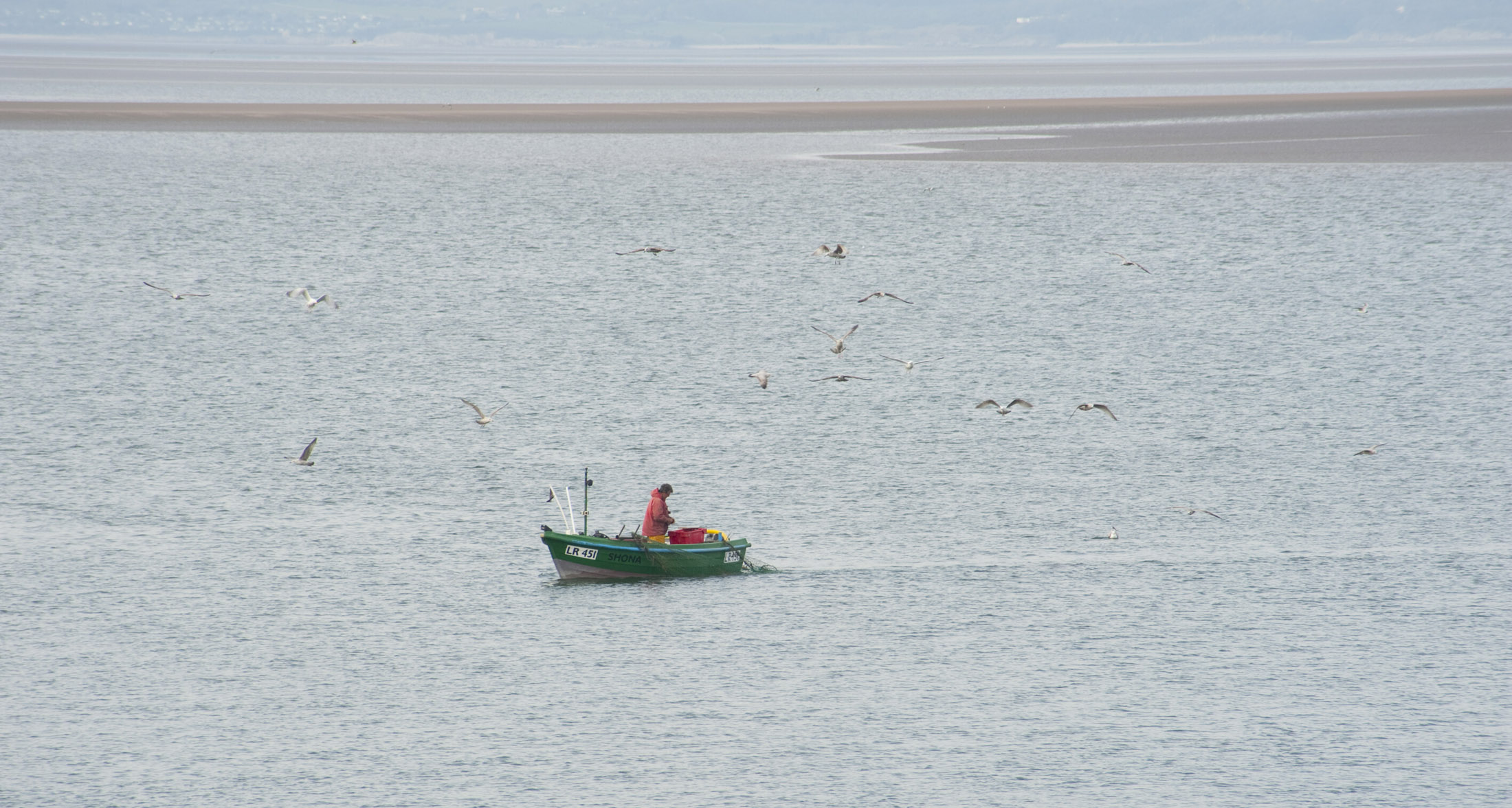 fishing from a small boat on morecambe bay