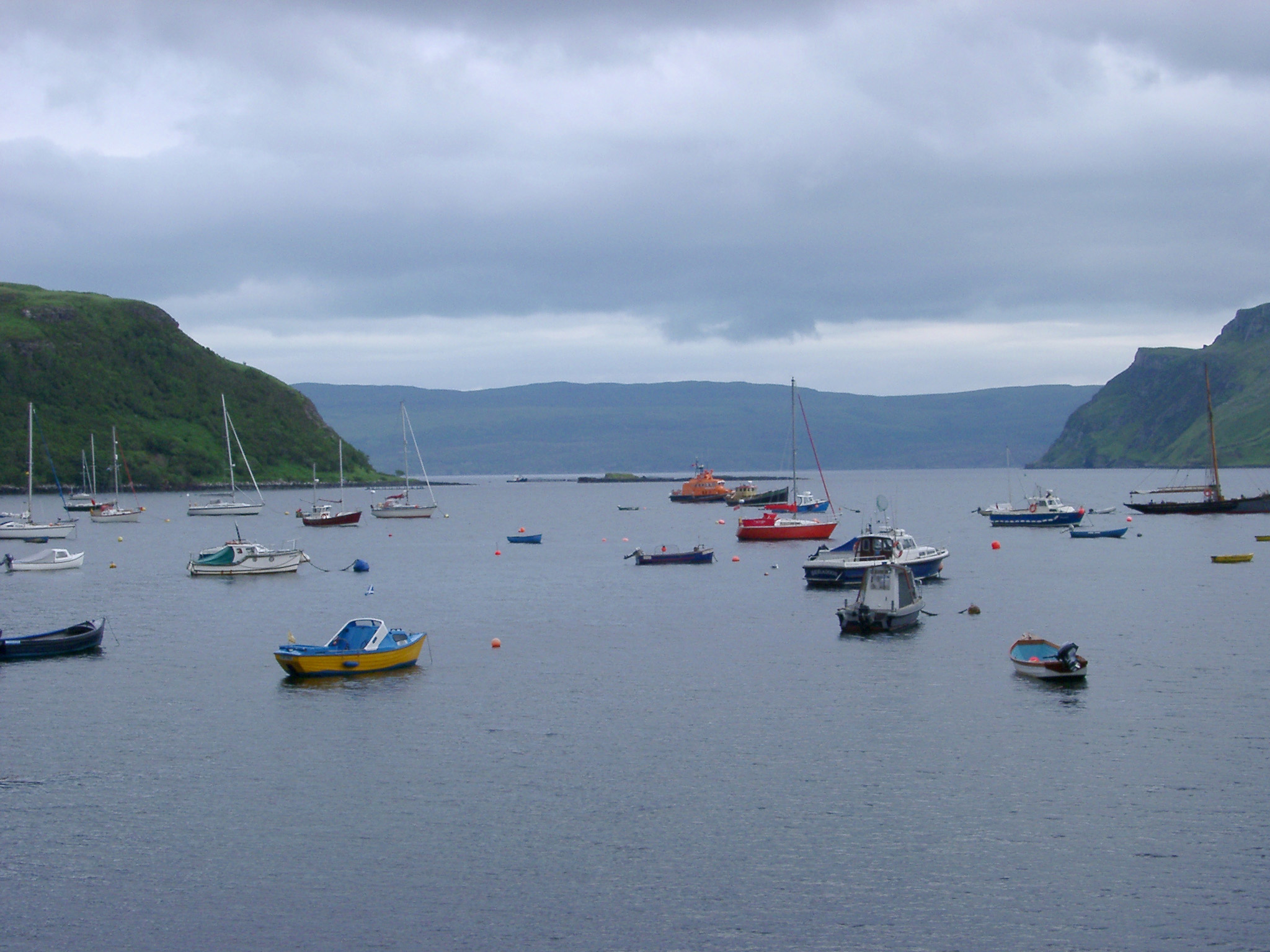 fishing and pleasure boats in the harbour at portree, hebrides scotland