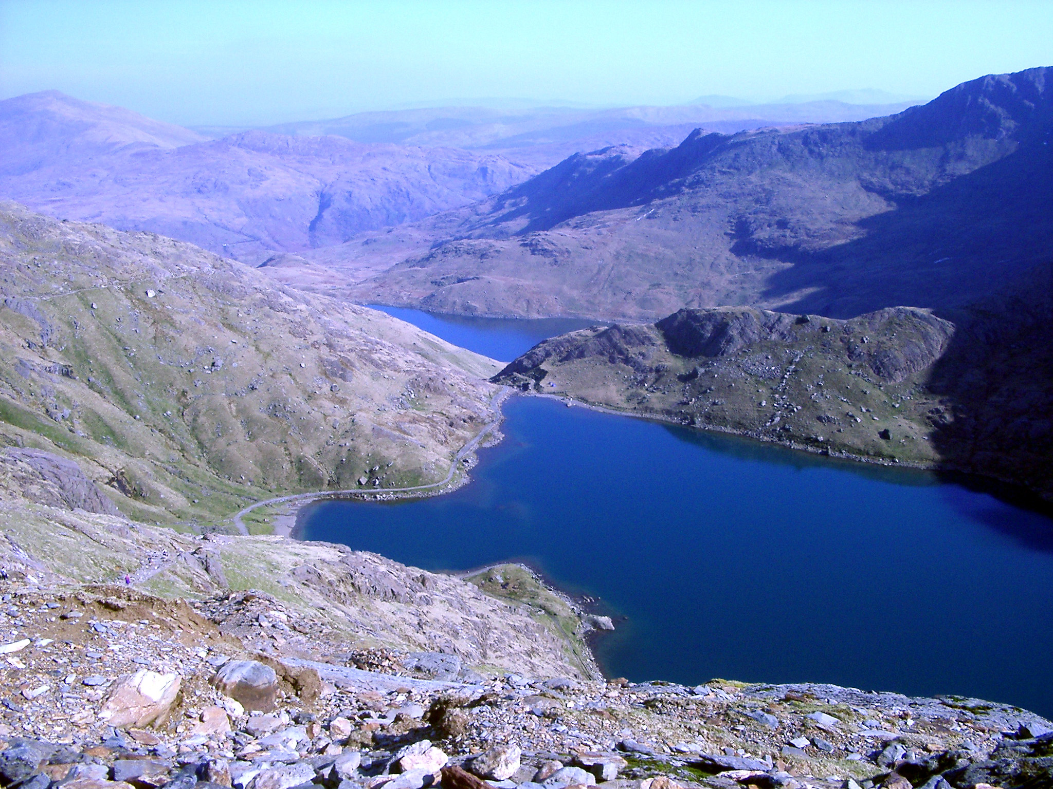 View from Snowdon of a beautiful blue mountain lake in the Welsh wilderness, Gwynedd, Wales, UK