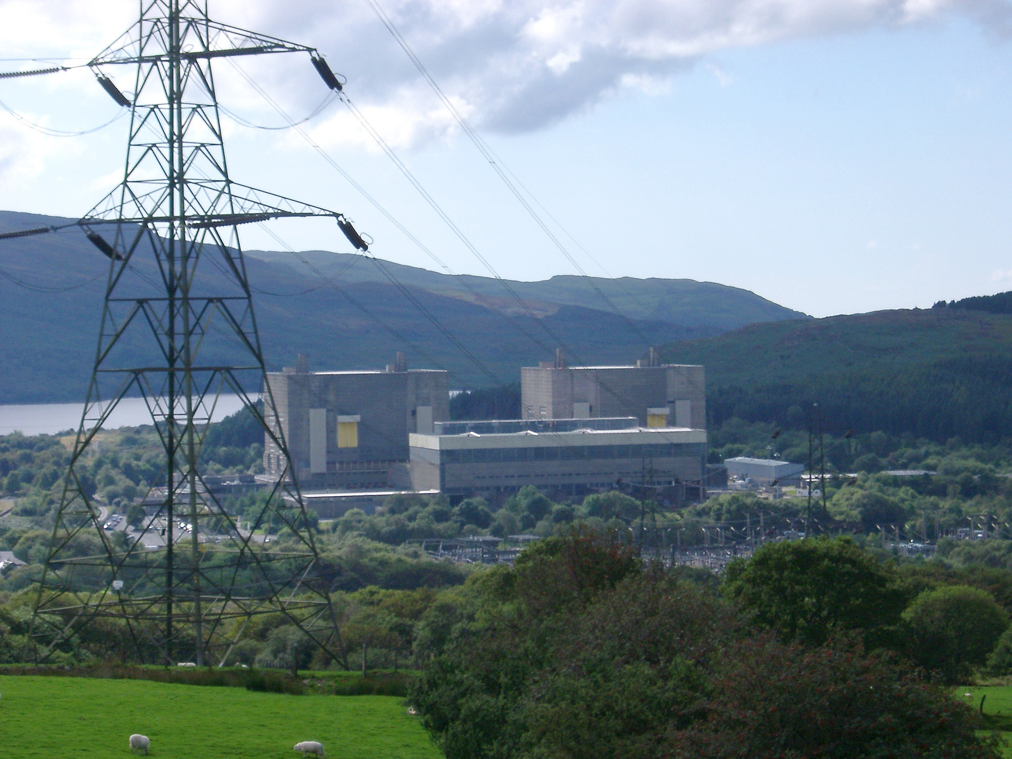 Nuclear Power Station in Trawsfynydd, Wales, showing an exterior view of the buildings and installation with an electric pylon and cables in the foreground