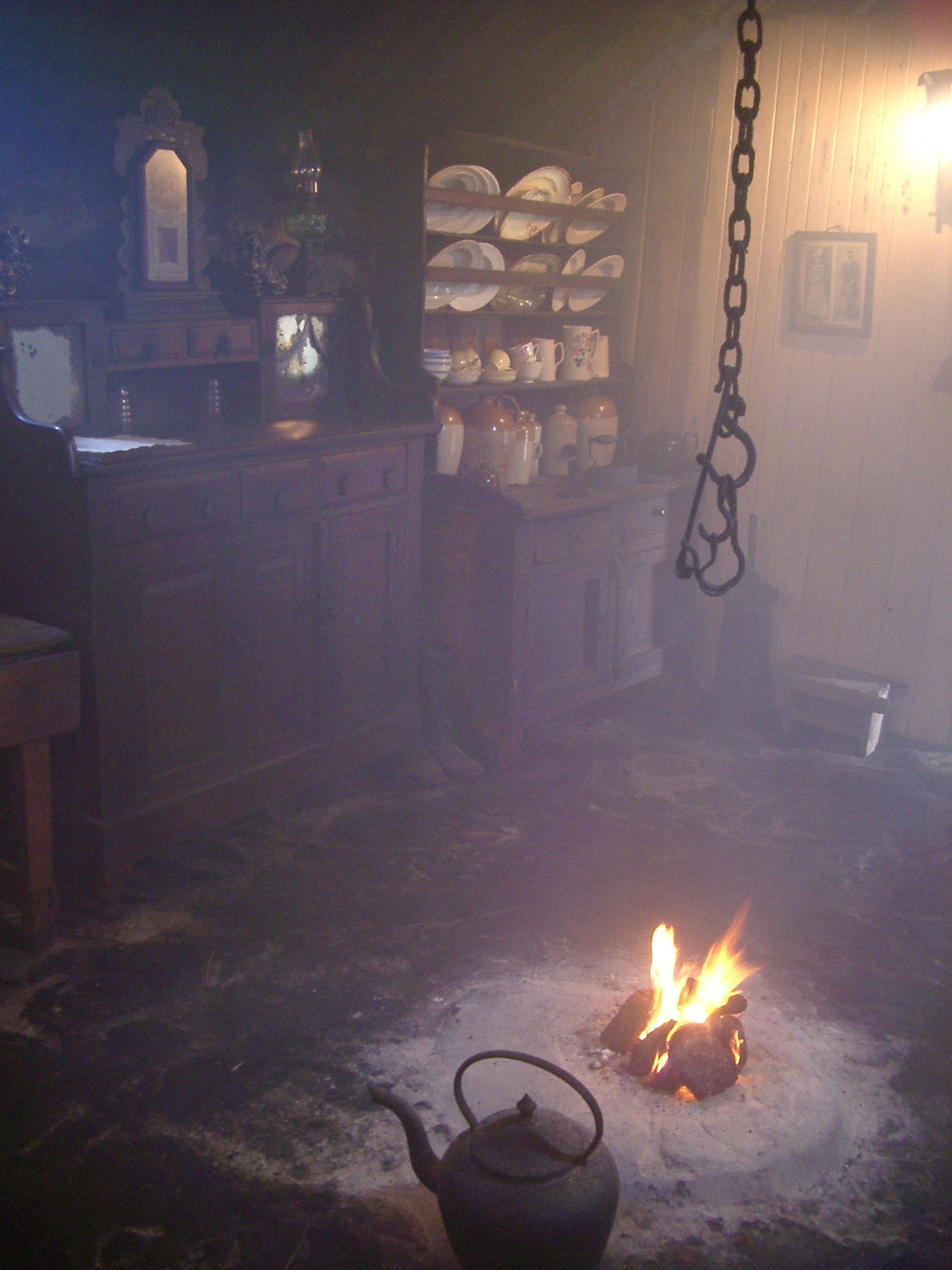 smoky dark interior of a blackhouse, a historic traditional scotts highland dwelling without glass windows