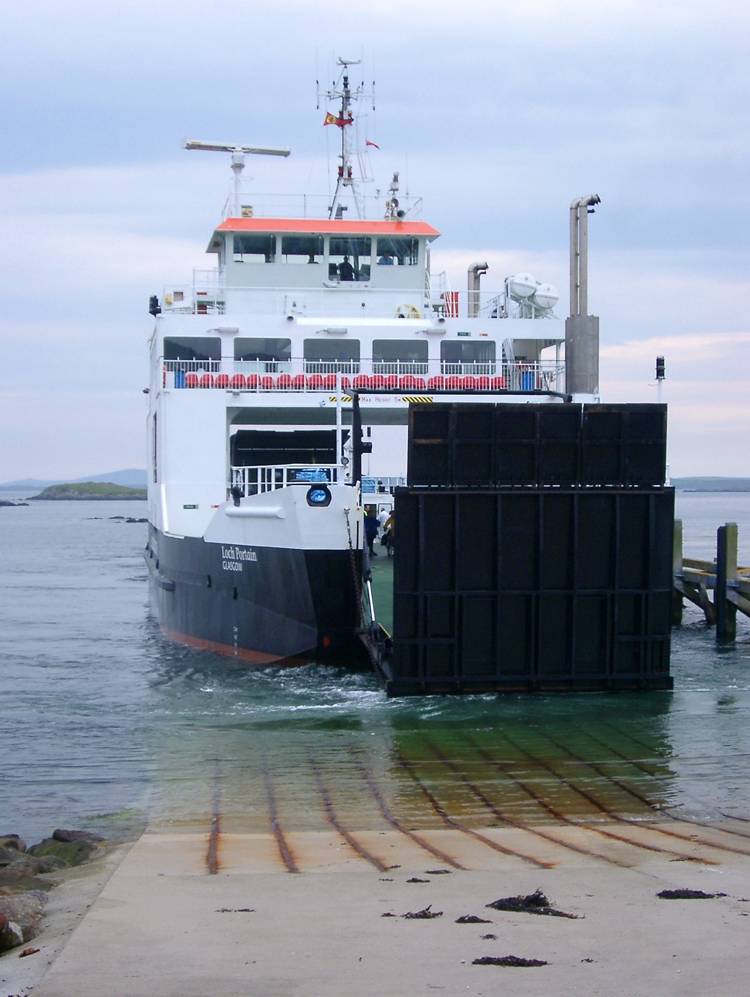 Large black and white ferry Resting at the Sea Port, with clear sea water, in Scotland