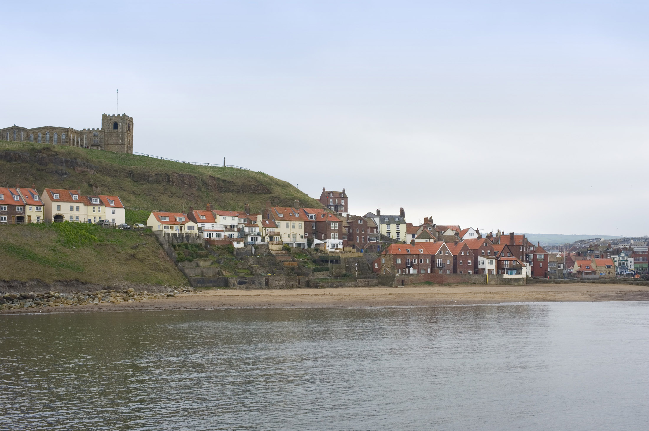 st marys church on top of the east cliff and below the houses on tate hill and tate sands, whitby lower harbour