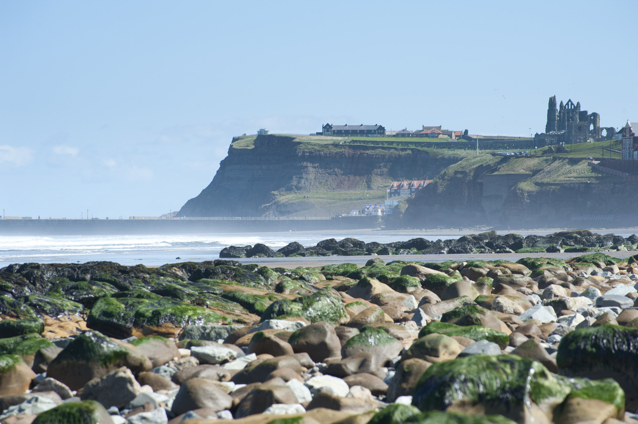 headland to the east of whitby with the landmark abbey ruins on top
