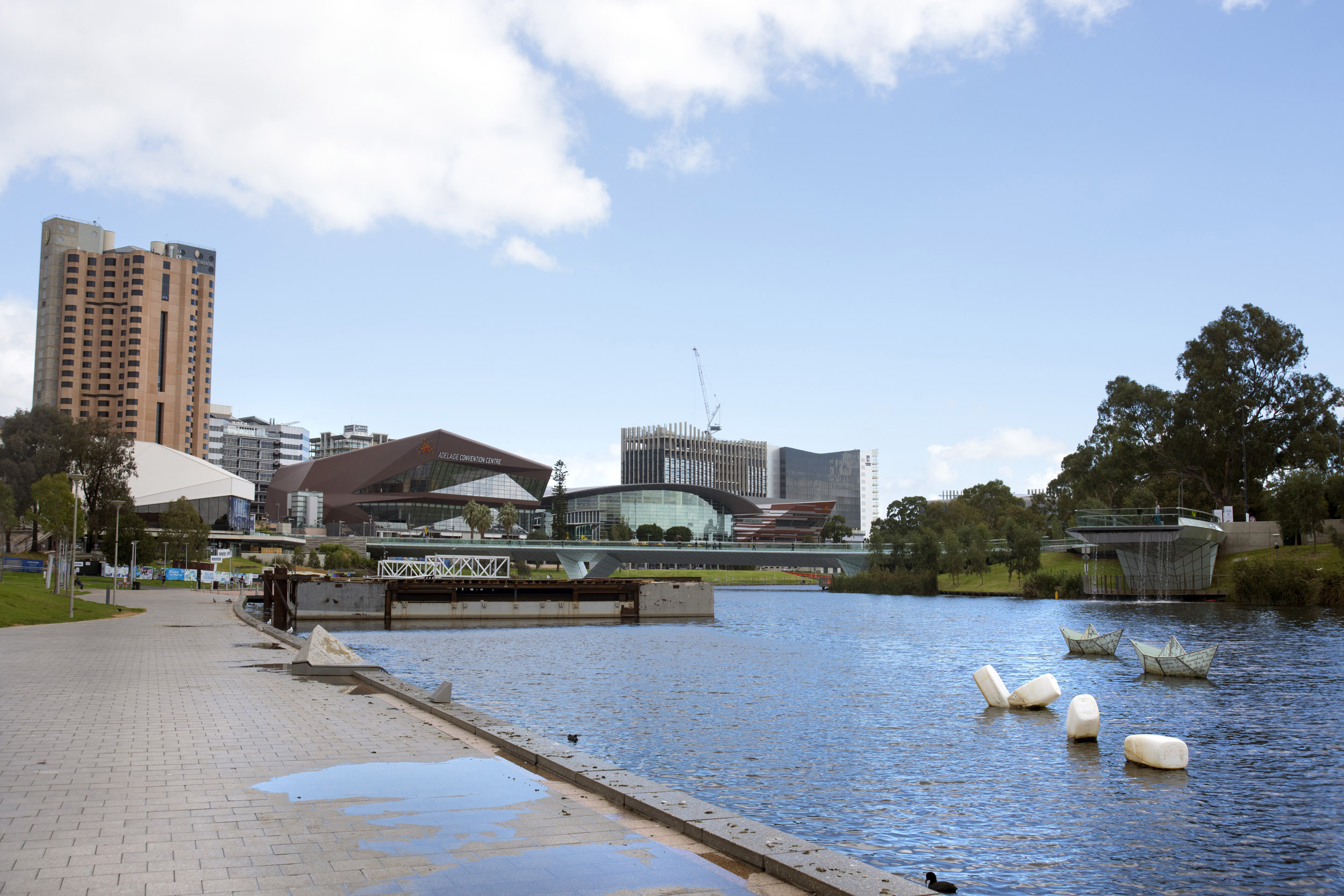 River in the city of Adelaide with high rise buildings in background, Australia.