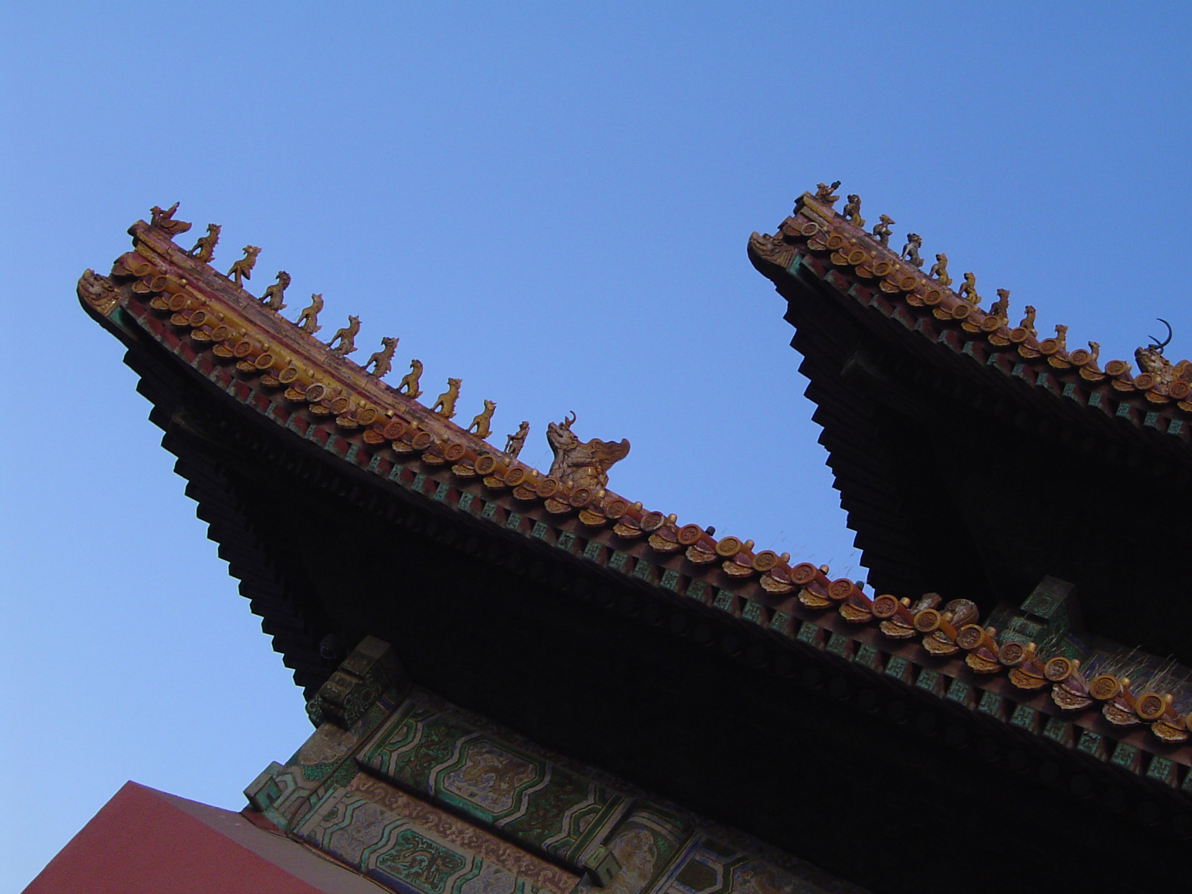 Artistic Details of Famous Vintage The Forbidden City Palace in Beijing, China on Light Blue Sky Background.