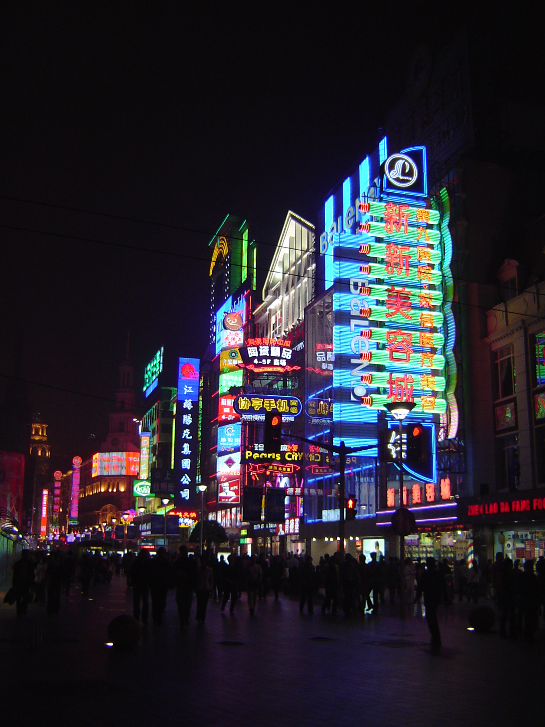 Attractive Colorful Neon Lights From Various Commercial Buildings in Chinese City View at Night Time.
