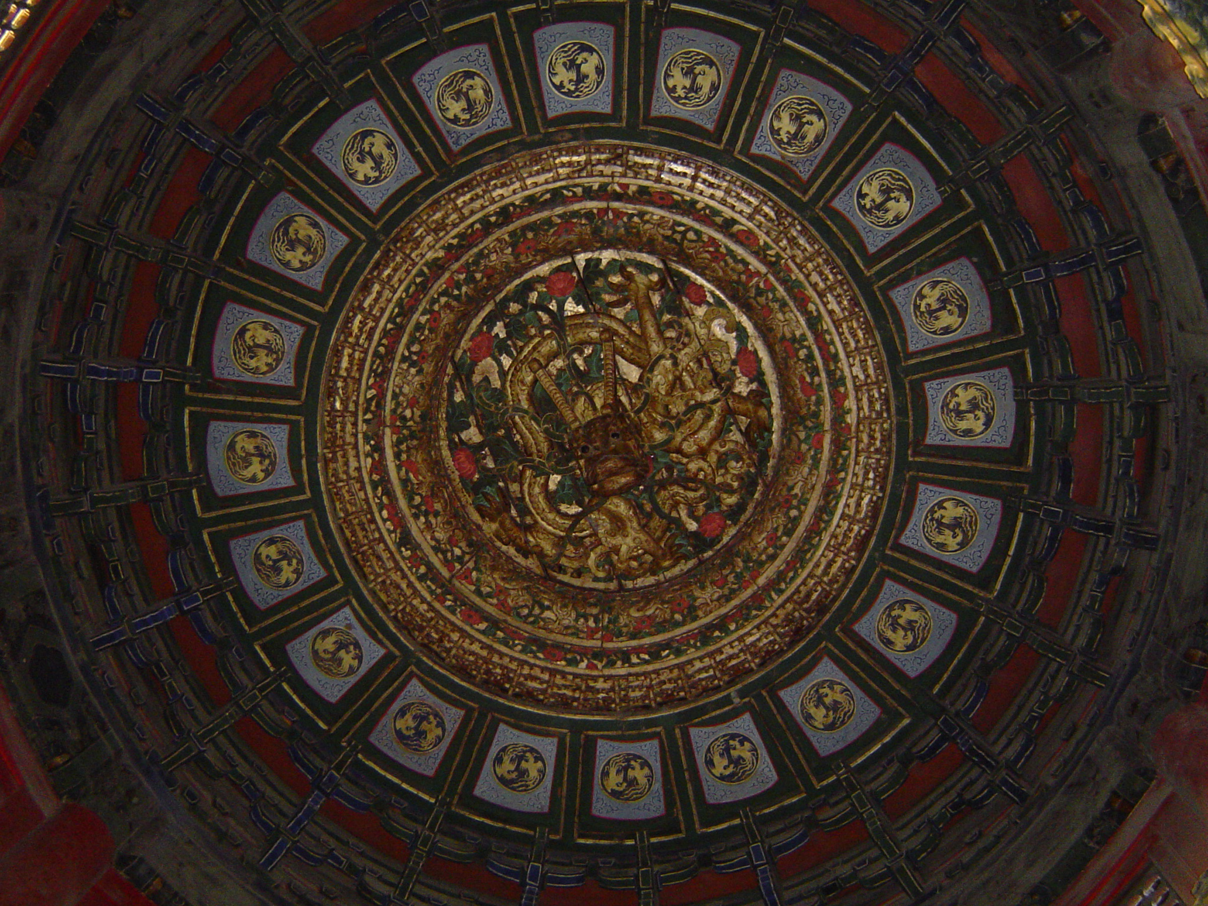 Circular Artistic Ceiling Design of Vintage Temple of Heaven in Beijing China.