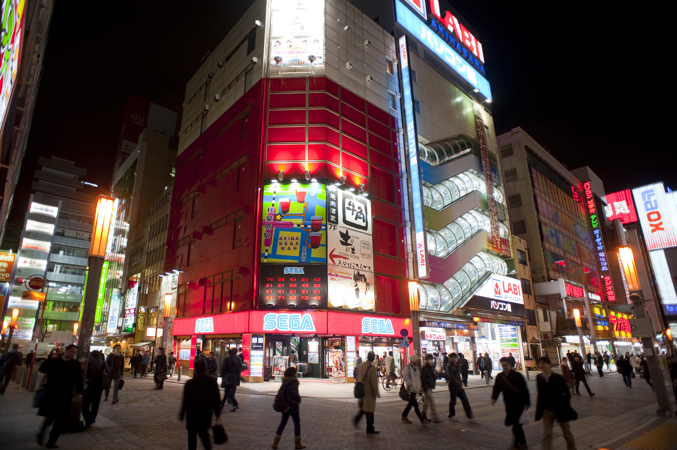 brightly lit stores at night in akihabara - electric town, tokyo, japan