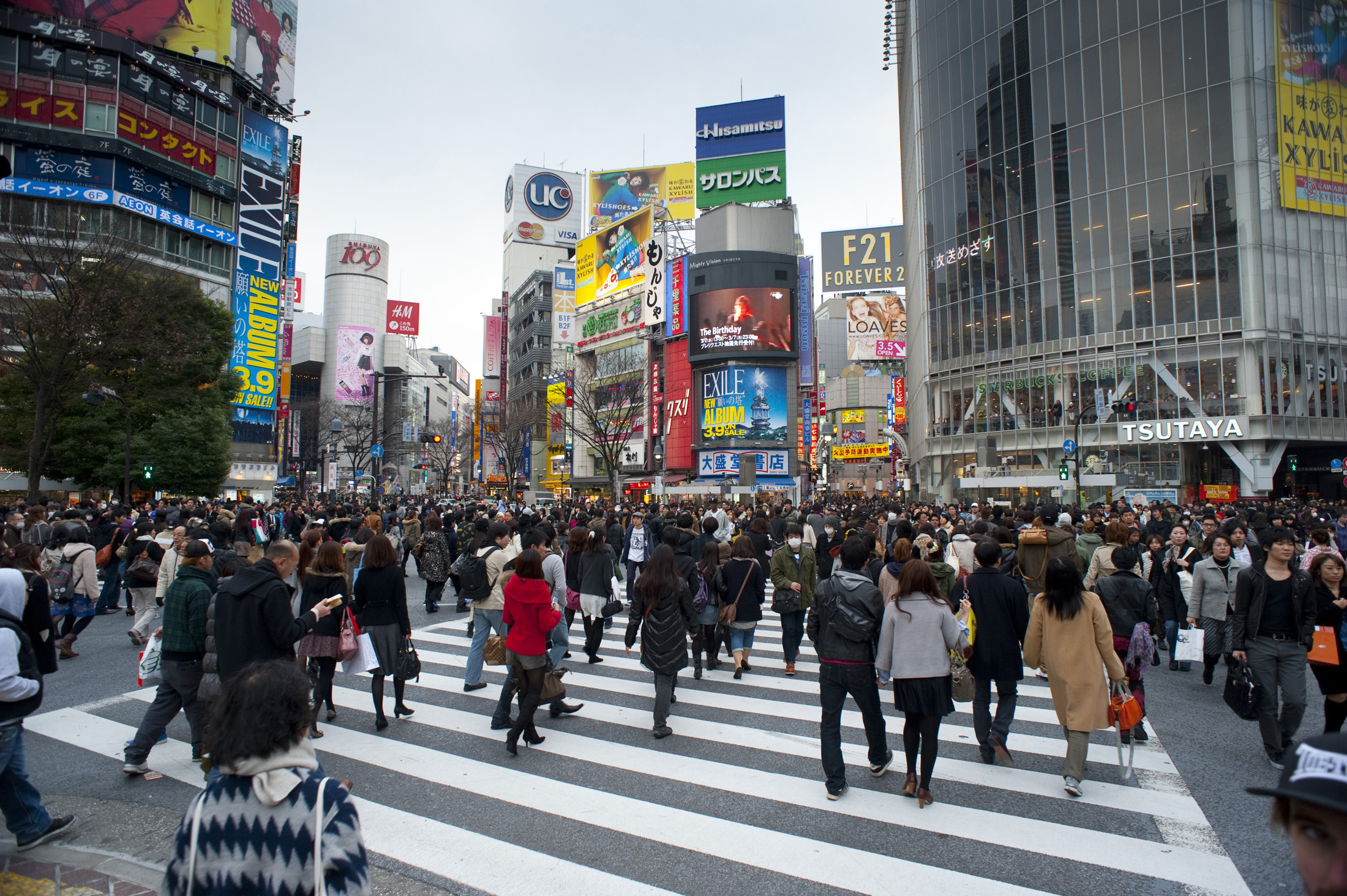 flashy advertisings and crowded streets are a feature of the shopping district in shibuya, tokyo, japan