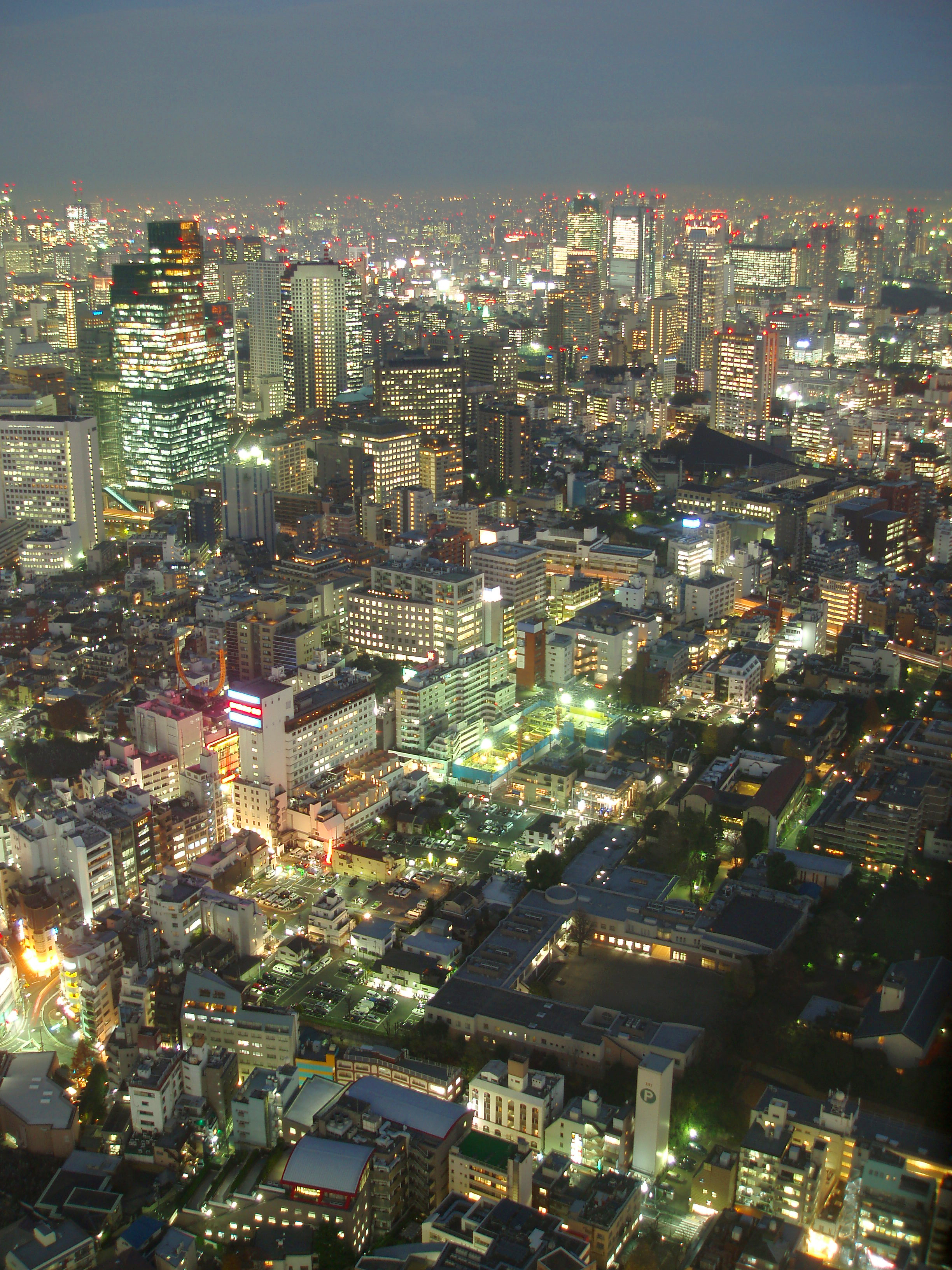 spectacular aerial view of tokyo brightly lit at night
